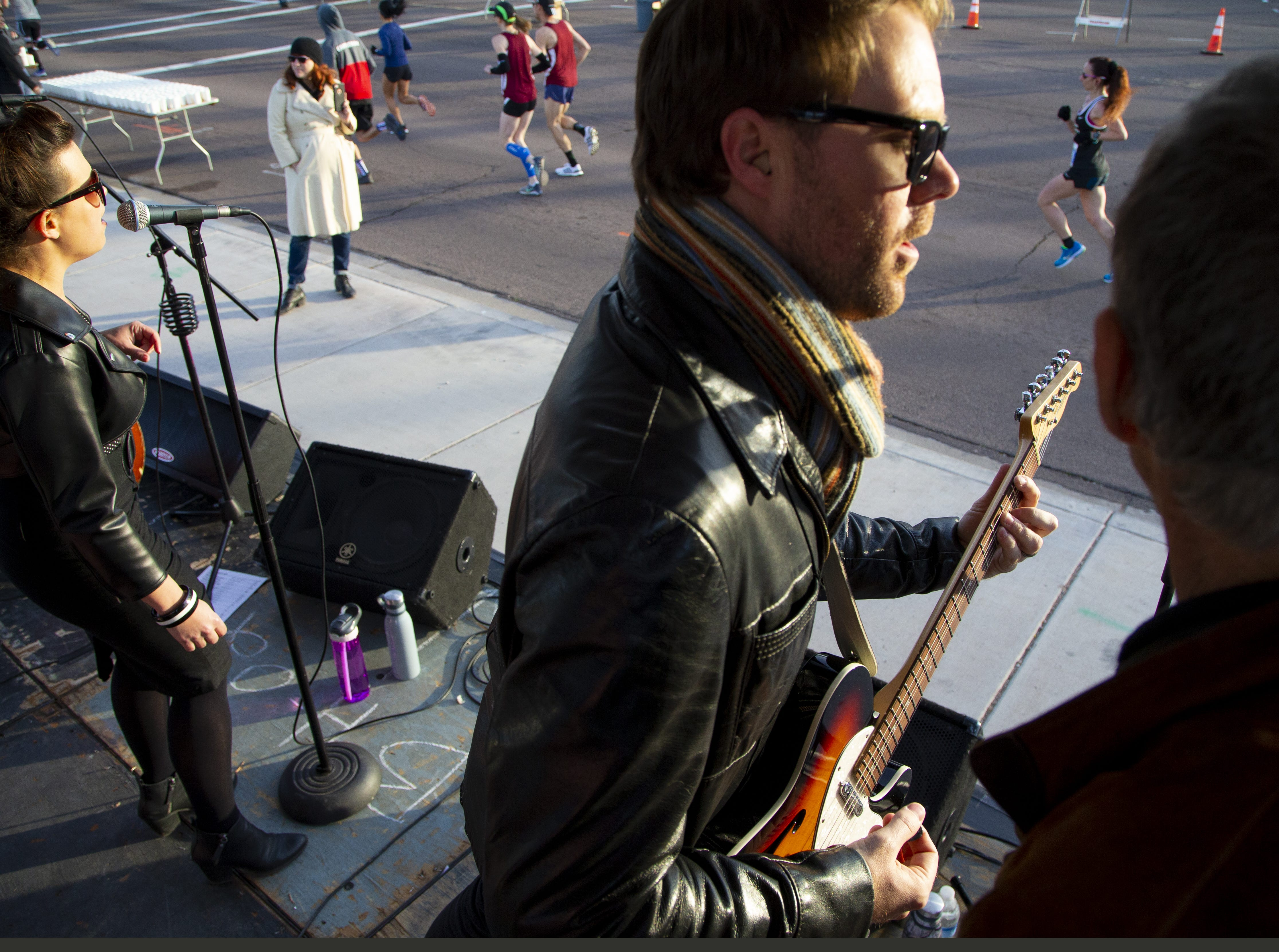 Whiskey Kiss lead singer Niki White, and guitarist Nick White, right, perform during Humana Rock 'n' Roll half marathon in on Jan. 20, 2019.