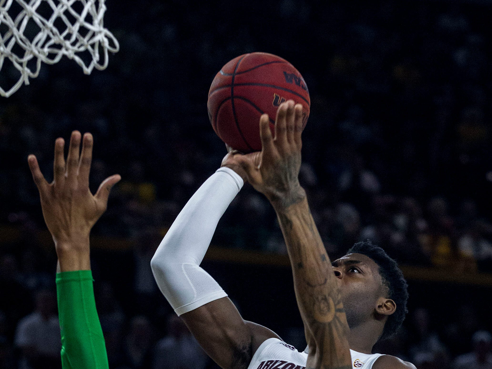 Arizona State's Luguentz Dort (0) drives the lane against Oregon's Kenny Wooten (14) during the second half, Saturday, Jan. 19, 2019, in Tempe, Ariz. Arizona State won 78-64. (AP Photo/Darryl Webb)