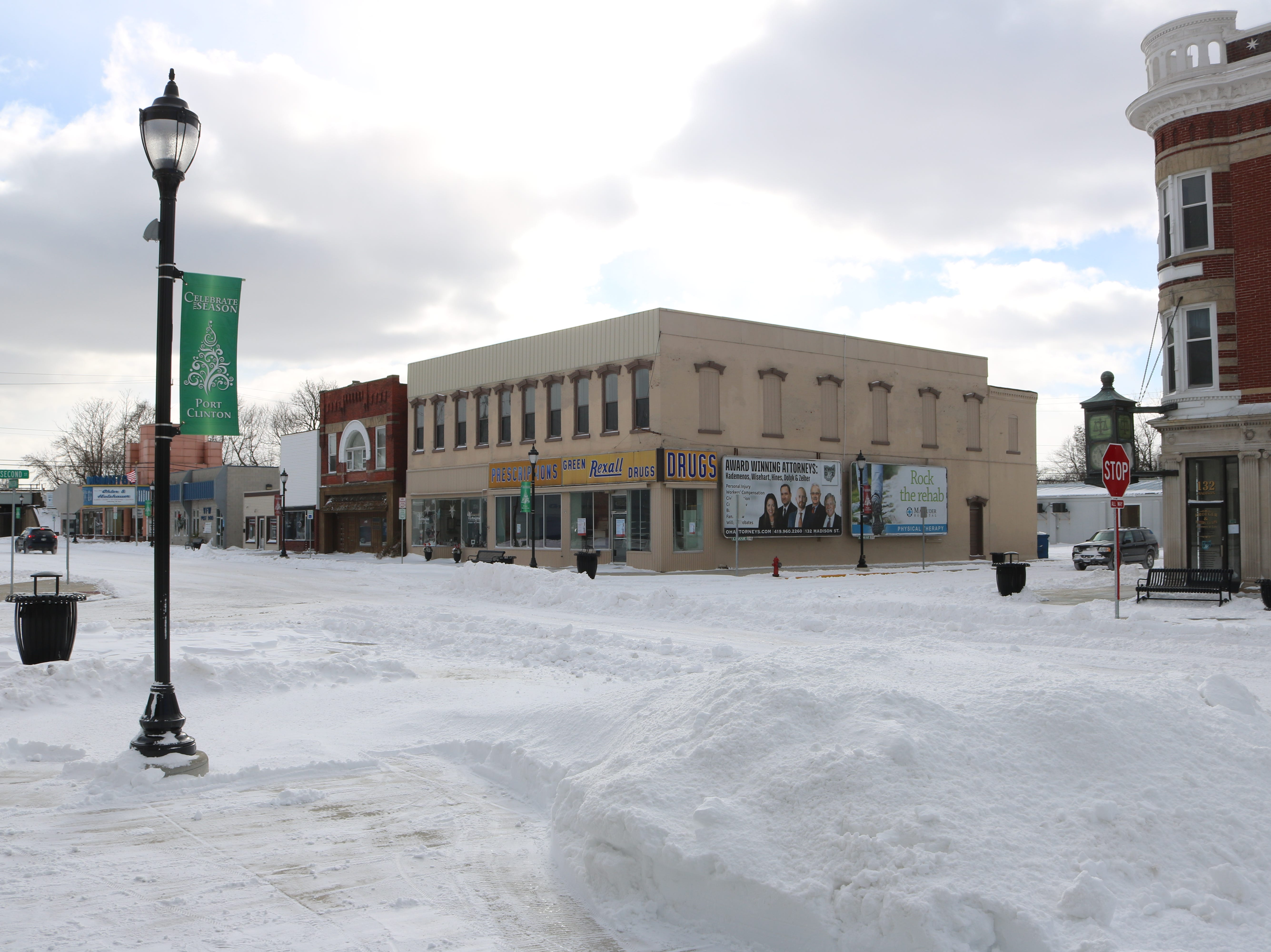 There was still plenty of snow on the roads Sunday, such as here in downtown Port Clinton.