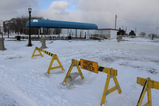 Flood waters along the coast of Lake Erie in the aftermath of Winter Storm Harper were frozen in place by Sunday as temperatures fell.