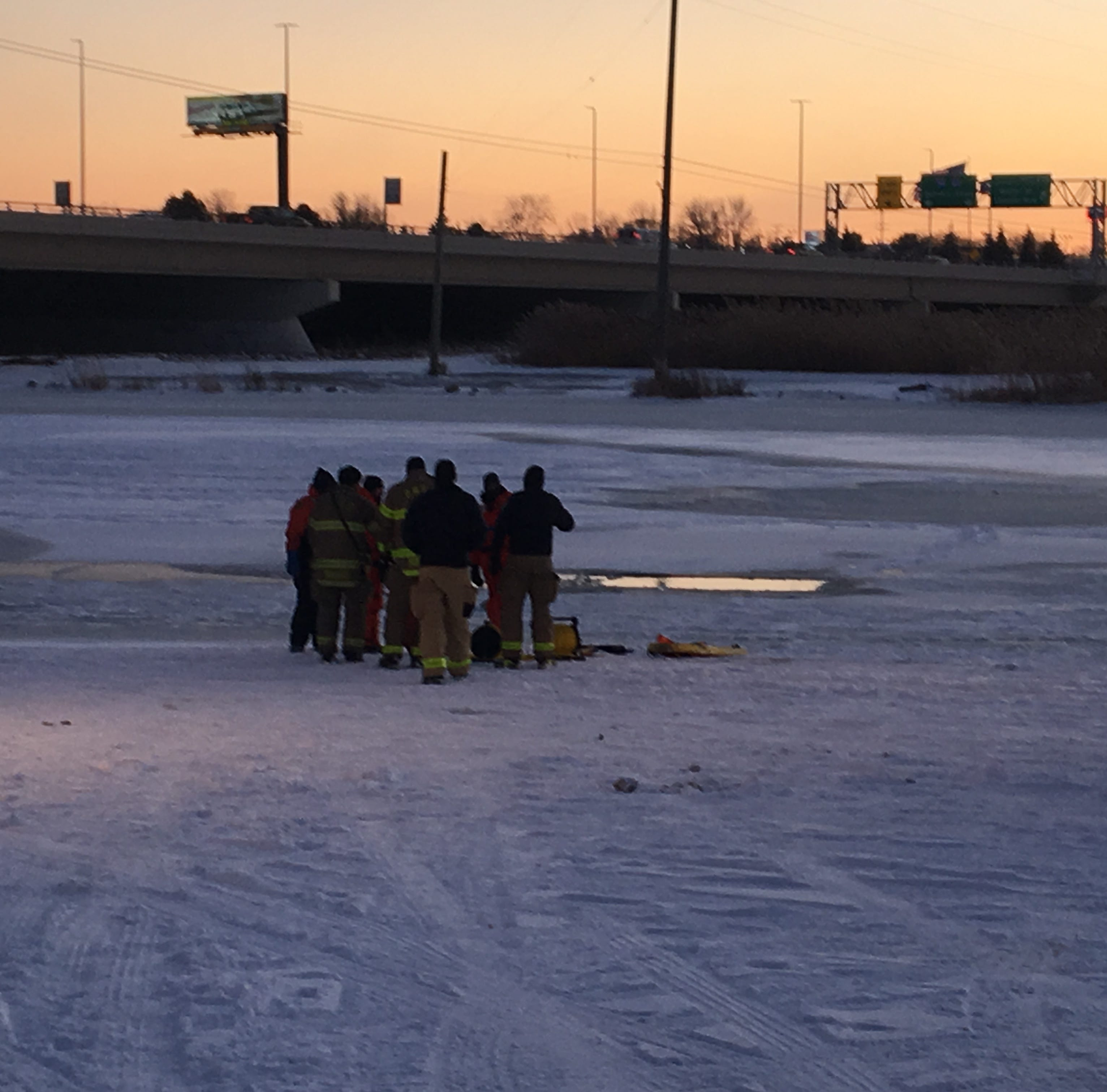 Dive team recovering snowmobile from Black River