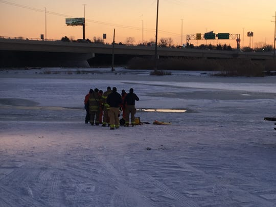 Rescue crews were called to a snowmobile having gone through the ice of the Black River in Port Huron Sunday afternoon.
