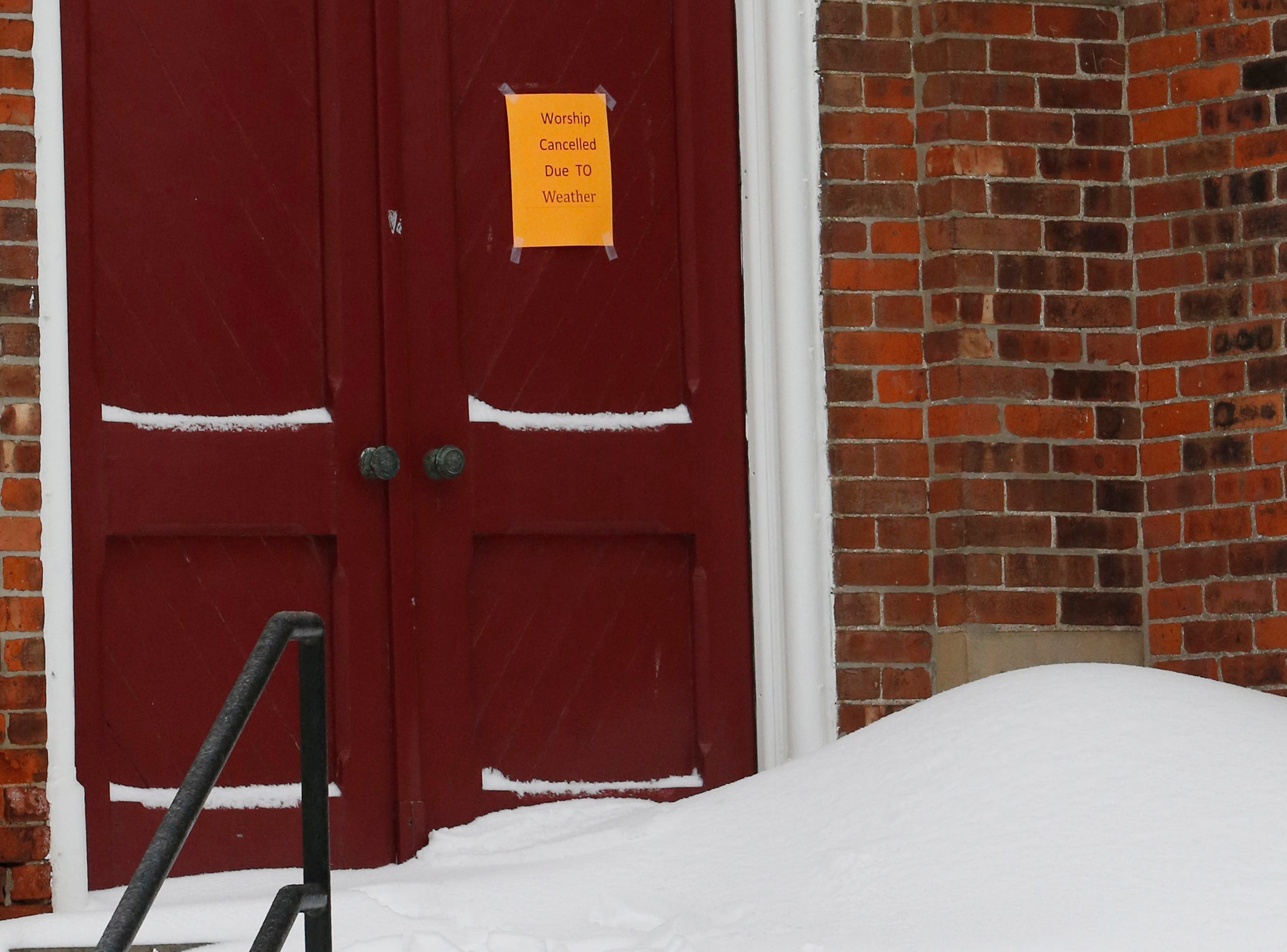 A sign posted on the door of the First Presbyterian Church in the Village of Wappingers Falls indicates that worship is cancelled due to the severe weather on January 20, 2019.