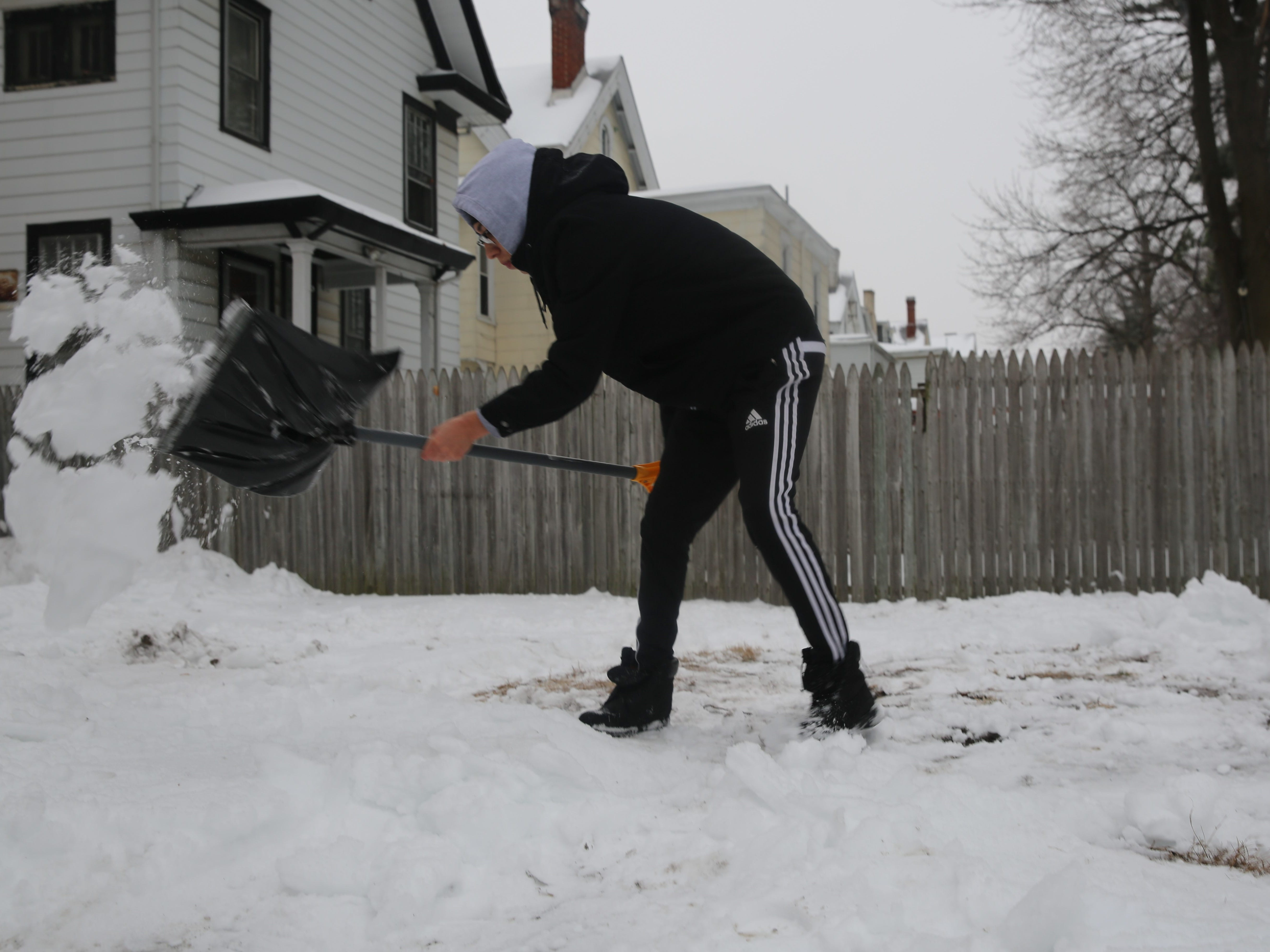Cristian Camargo, an 18-year-old Arlington High School senior, shovels his family's driveway in the City of Poughkeepsie on Sunday. His advice was to take it easy and not overwork himself.