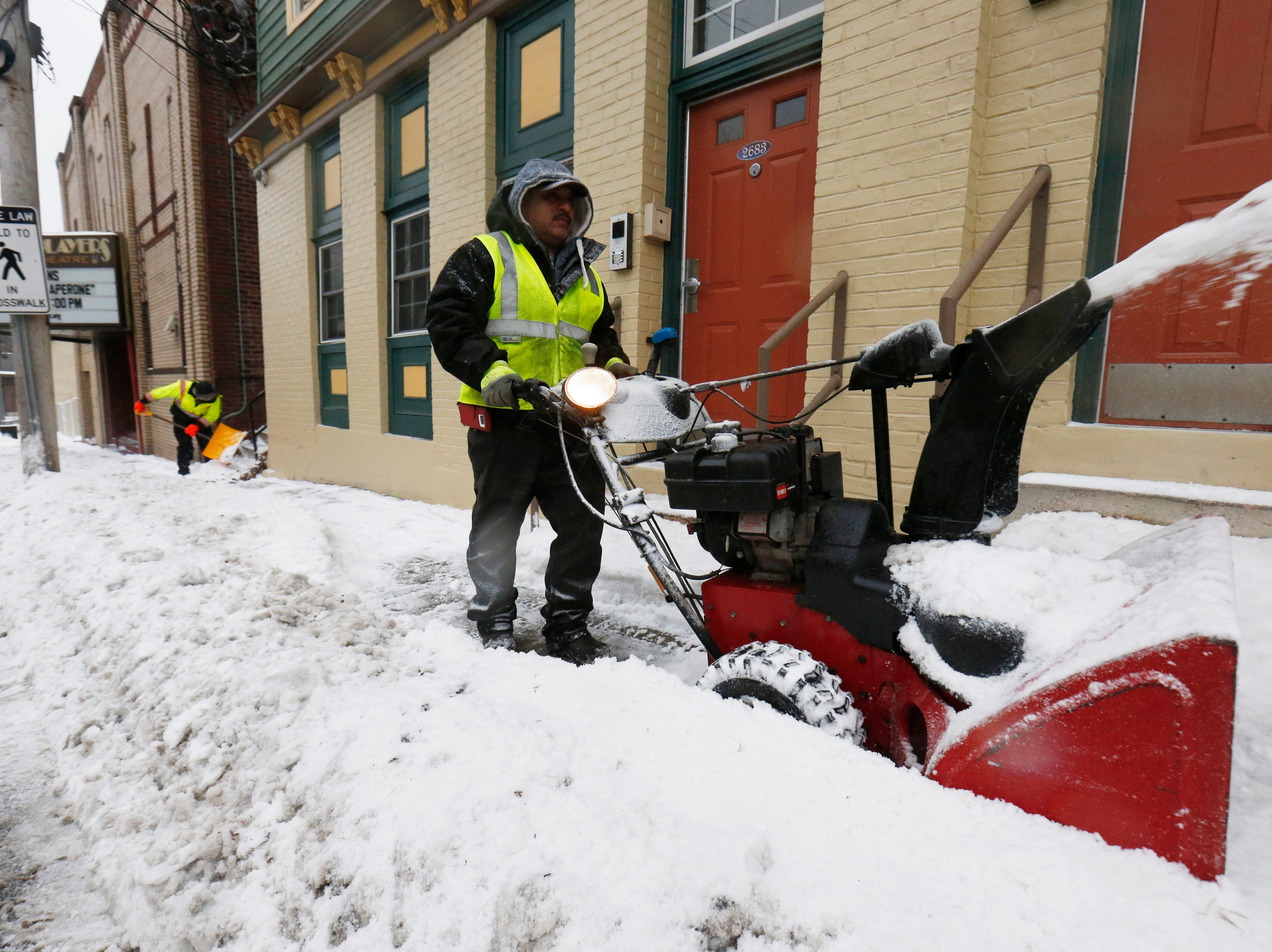 Mauricio Sibada clears the sidewalk as Christian Galindo works to clear steps along West Main Street in the Village of Wappingers Falls on January 20, 2019.