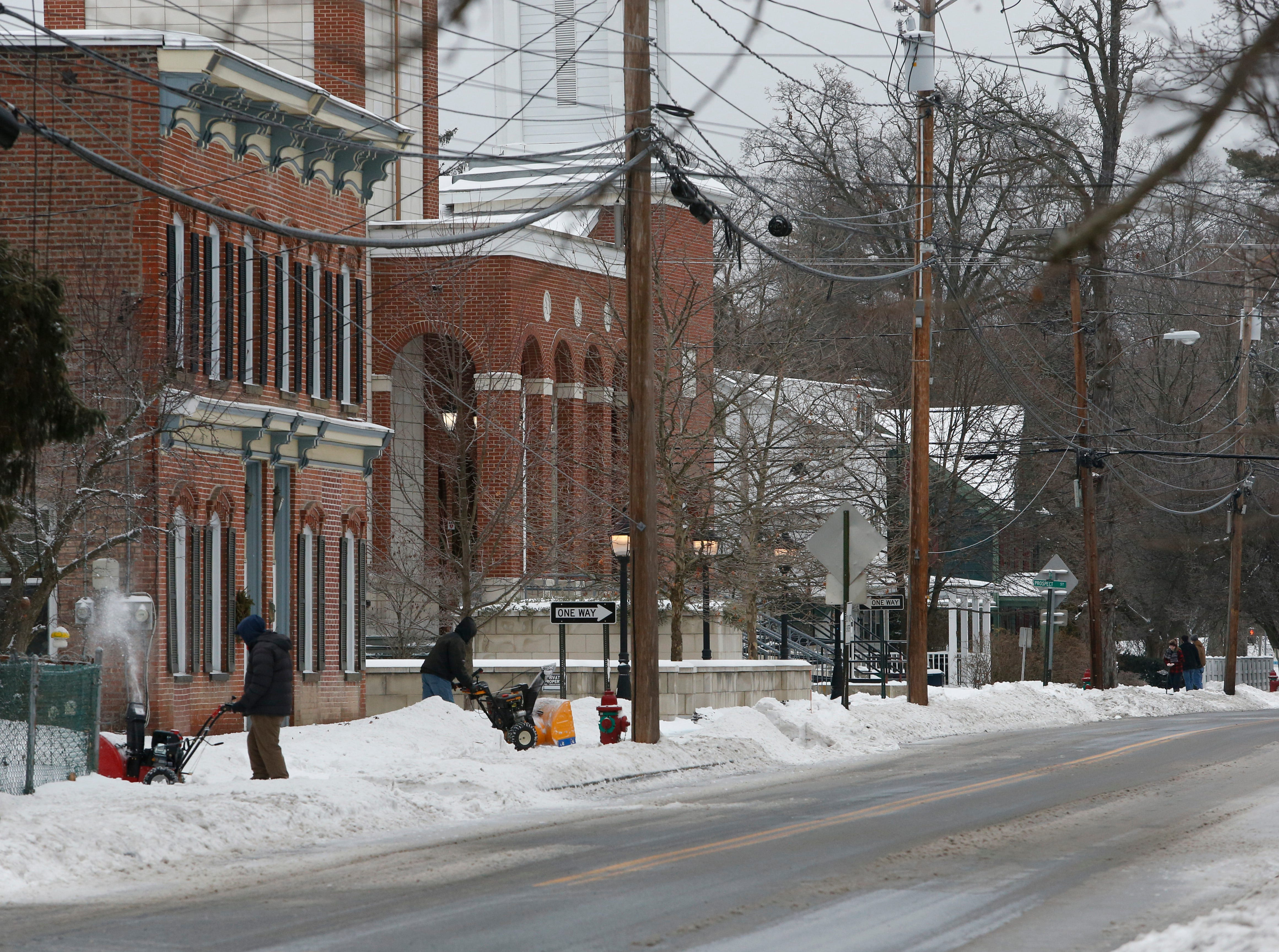 Residents clear sidewalks and driveways along South Avenue in the Village of Wappingers Falls on January 20, 2019.