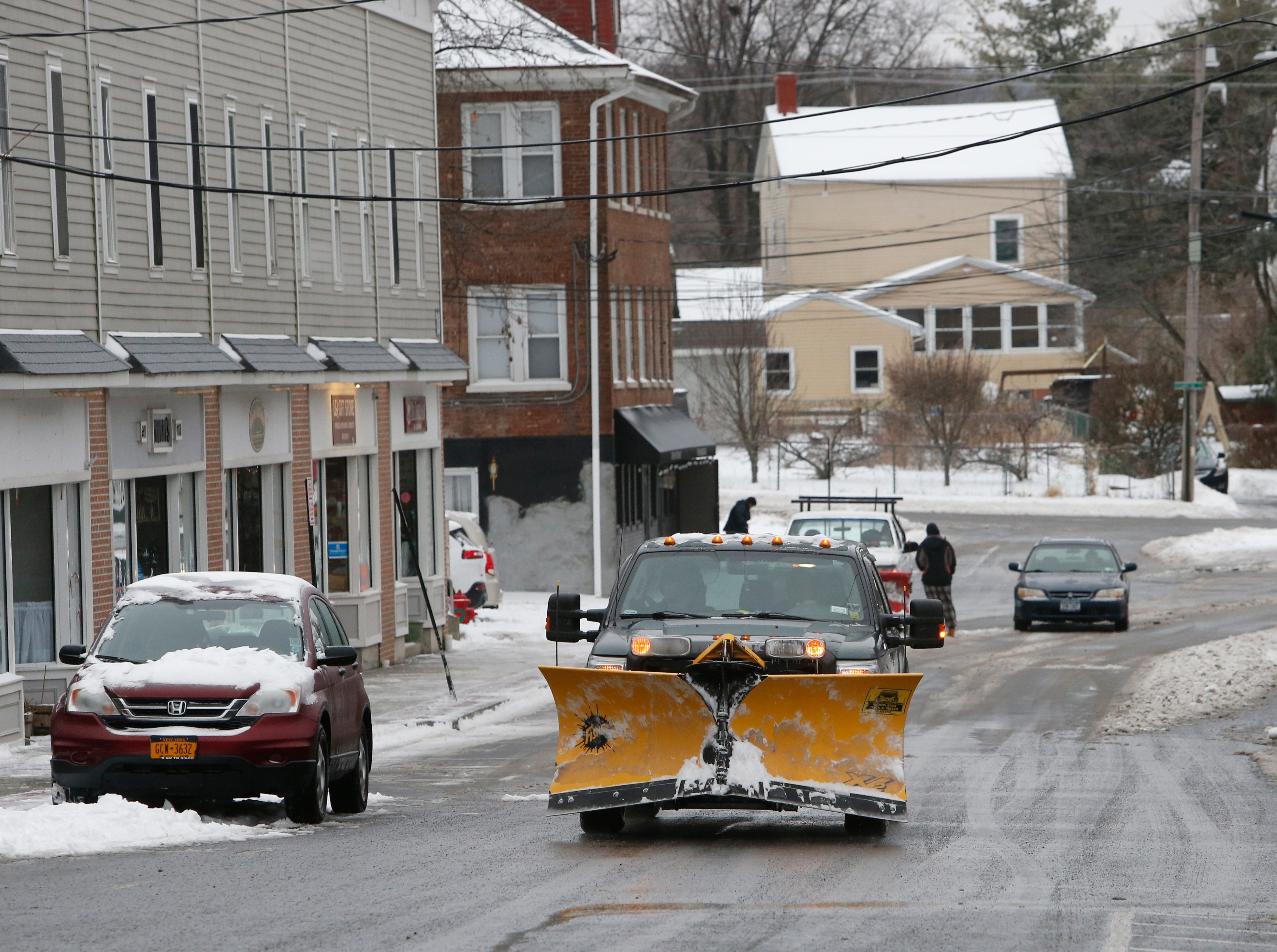 Residents dig out on Market Street in the Village of Wappingers Falls on January 20, 2019.