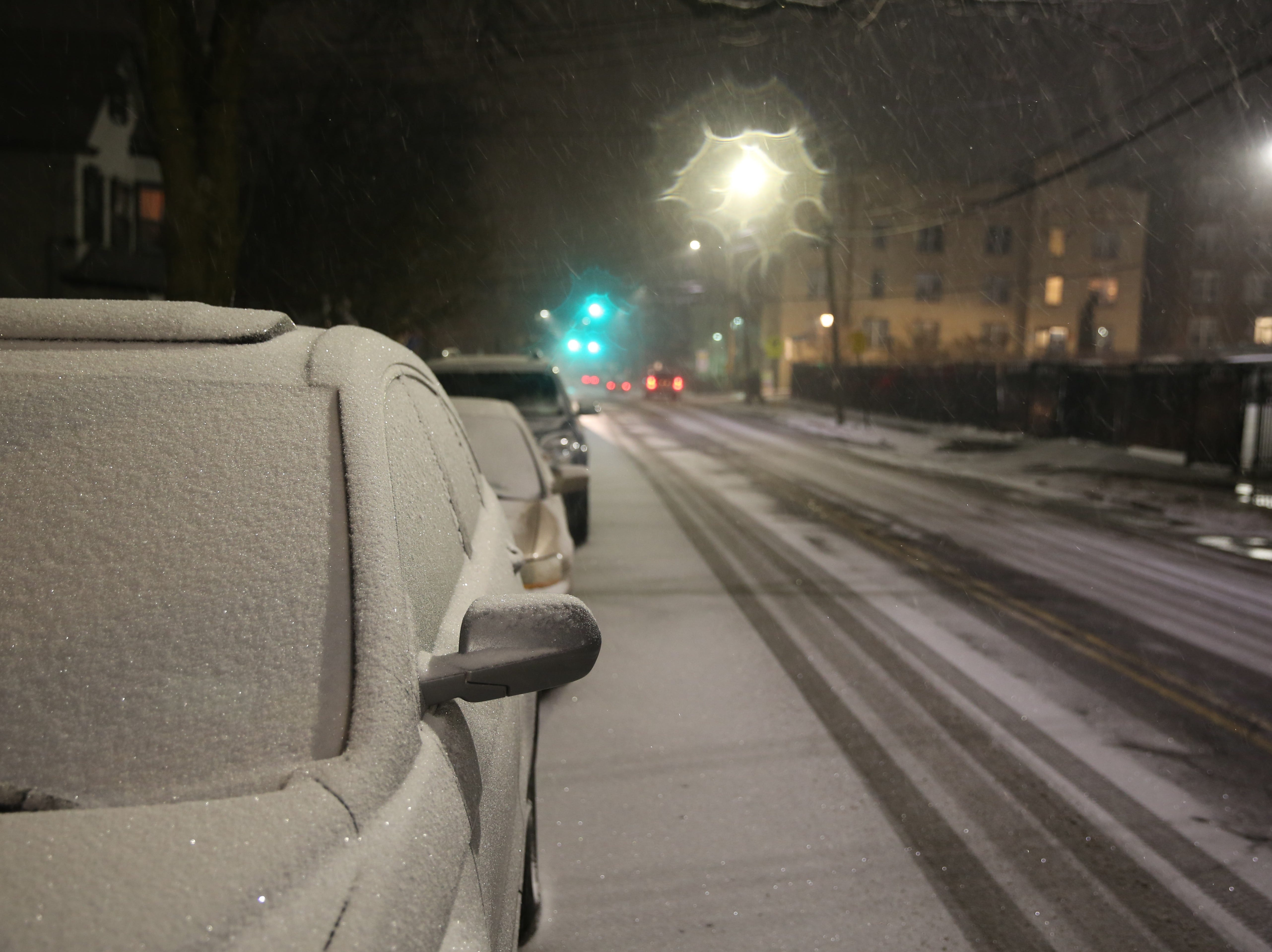 Snow collects on cars in the City of Poughkeepsie on Saturday night. The region is expected to get 4-8 inches of snow and possibly ice Saturday into Sunday.