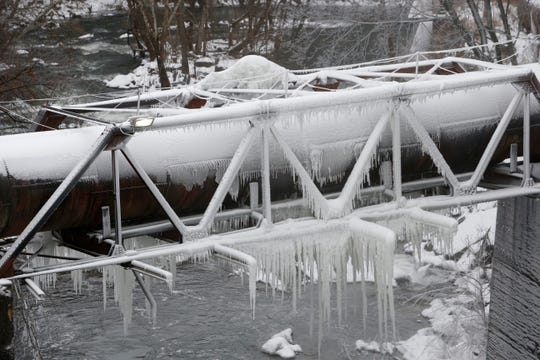 Ice covers the the aqueduct feeding the Wappingers Falls Hydroelectric plant in the Village of Wappingers Falls on January 20, 2019.