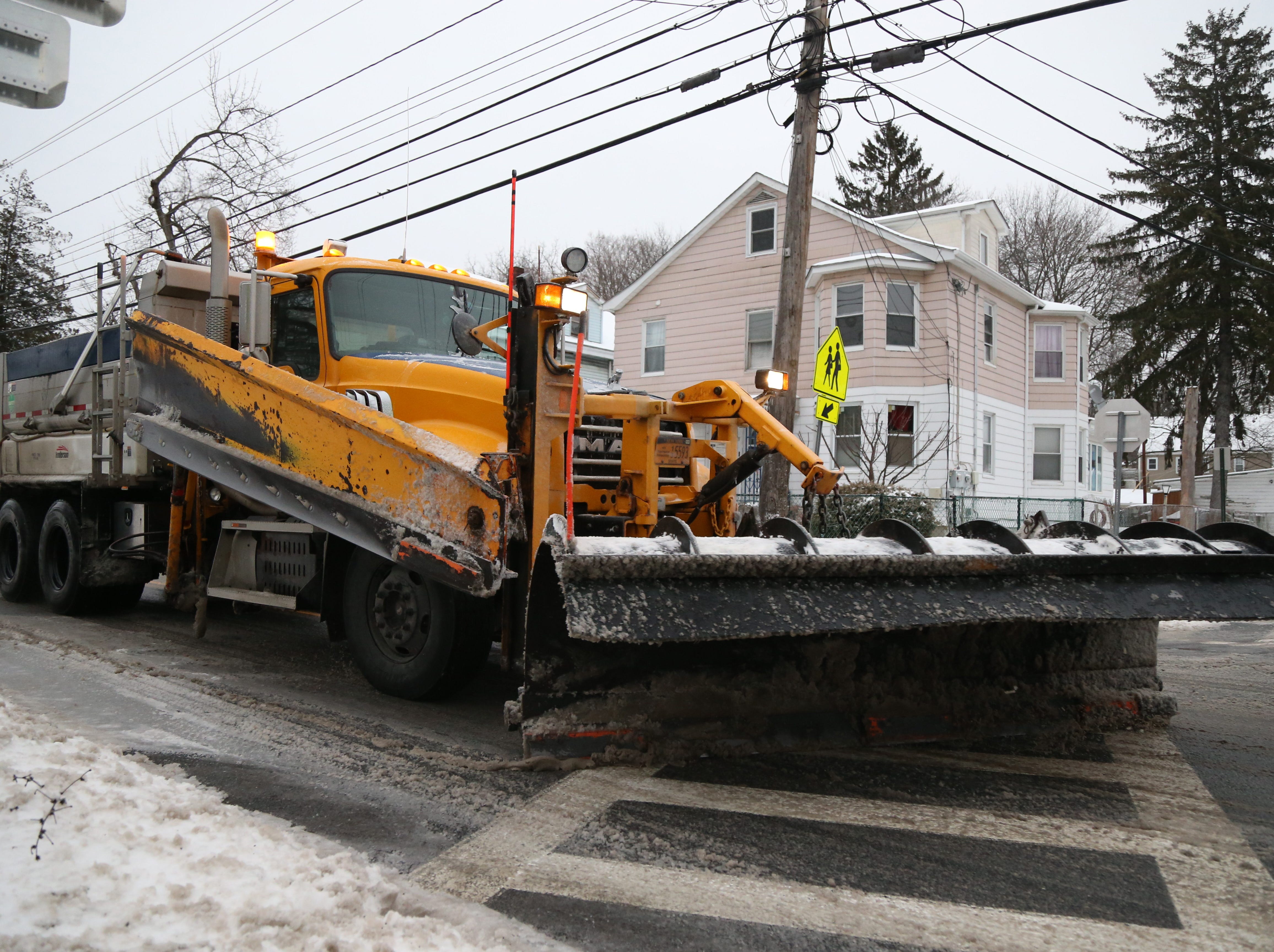 A New York State Department of Transportation plow truck travels south on Route 9D in the Village of Wappingers Falls on January 20, 2019.