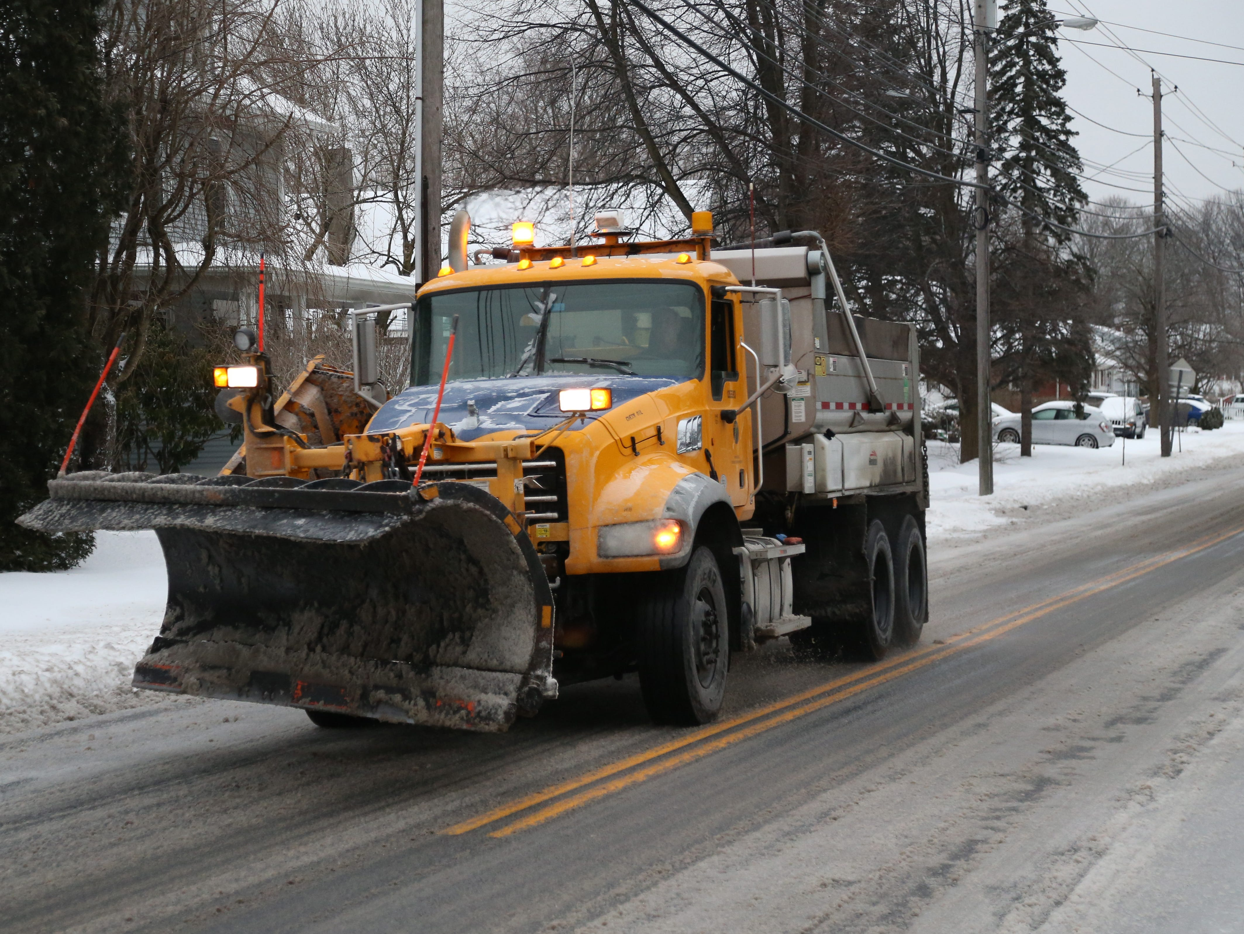 A New York State Department of Transportation plow truck travels north on Route 9D in the Village of Wappingers Falls on January 20, 2019.