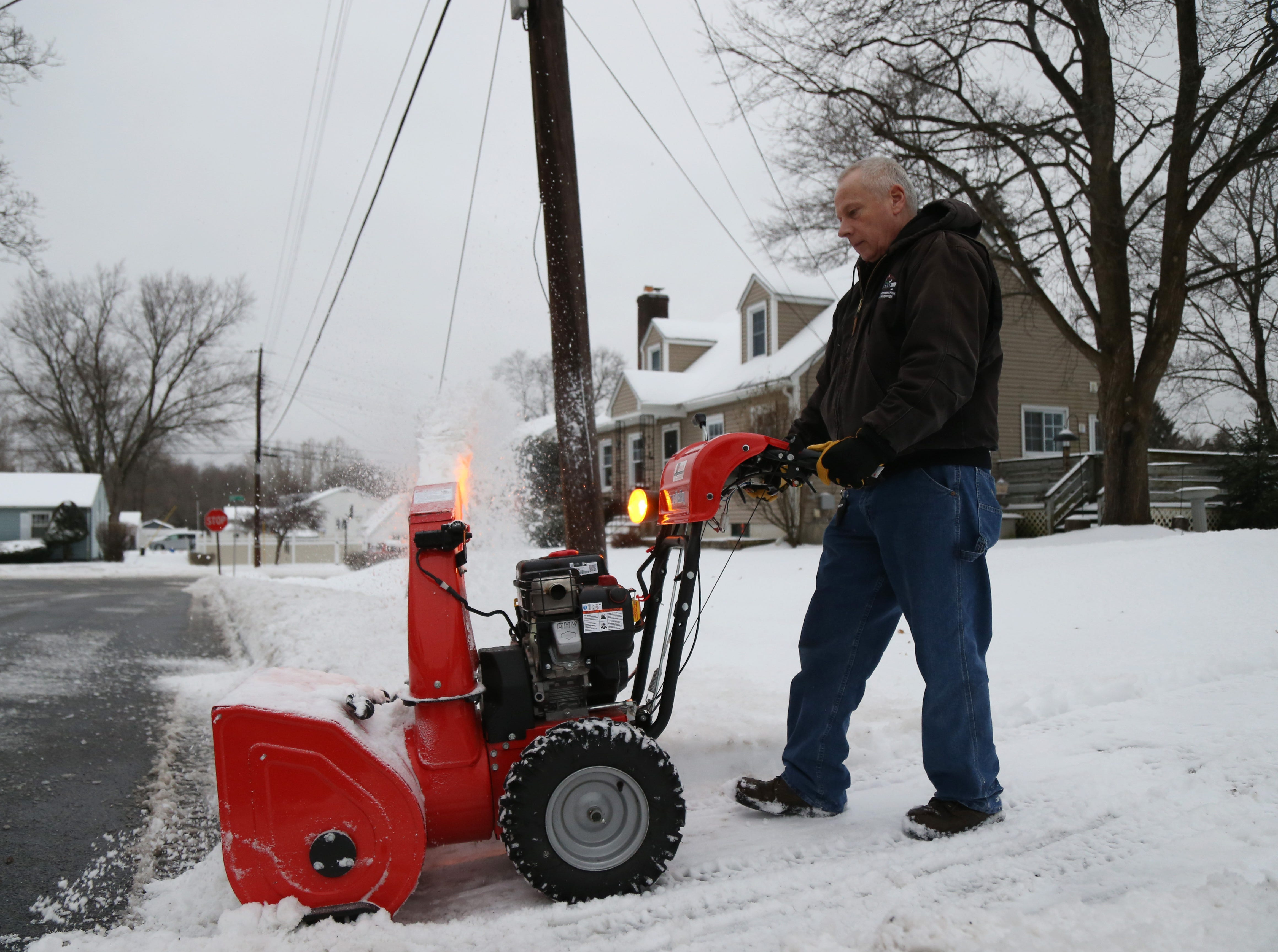 Steve Evans uses his snowblower to clear his driveway in the Village of Wappingers Falls on January 20, 2019. A winter storm brought snow and freezing rain overnight.