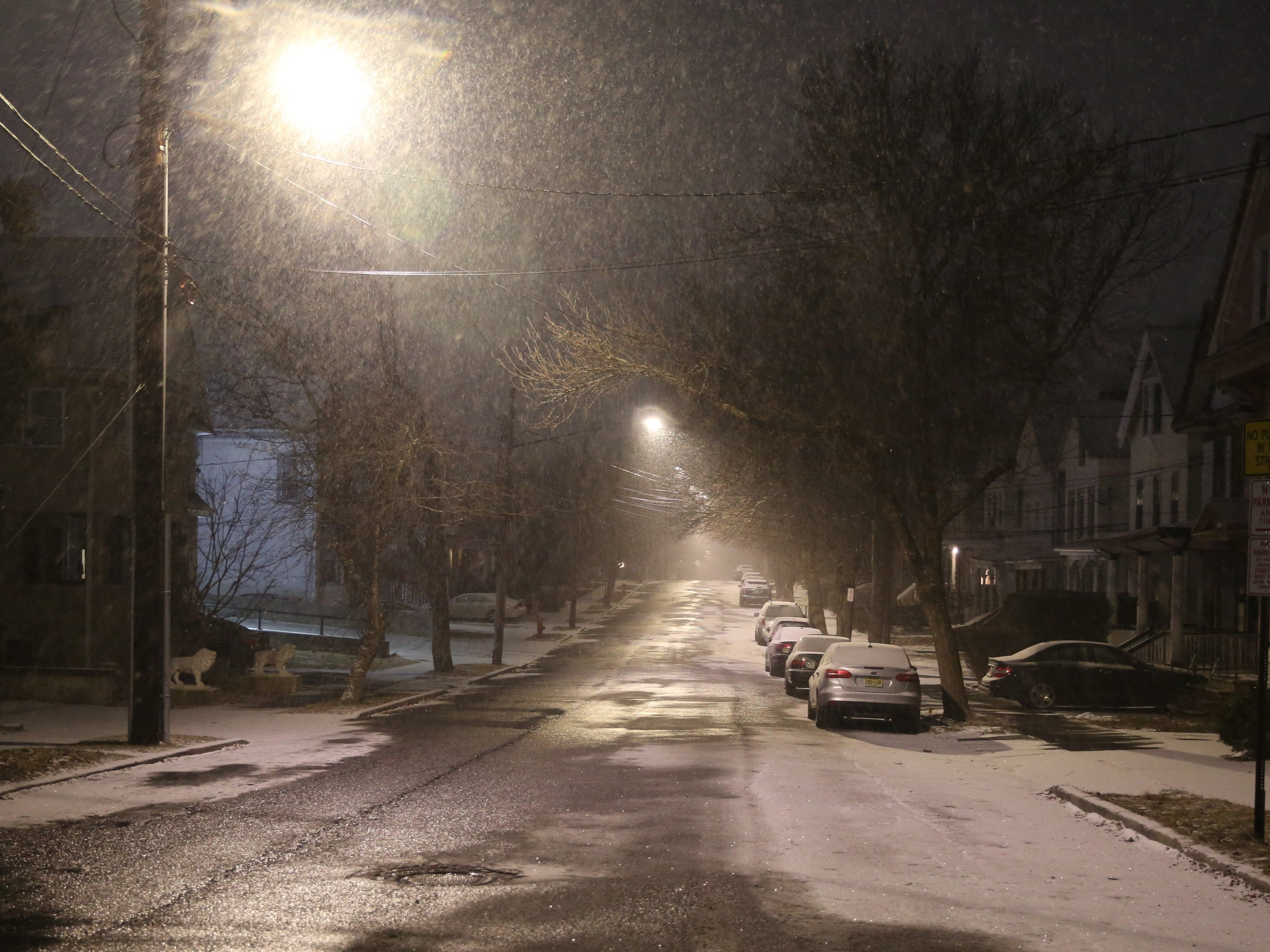Snow falls on a street in the City of Poughkeepsie on Saturday night. The region is expected to get 4-8 inches of snow and possibly ice Saturday into Sunday.