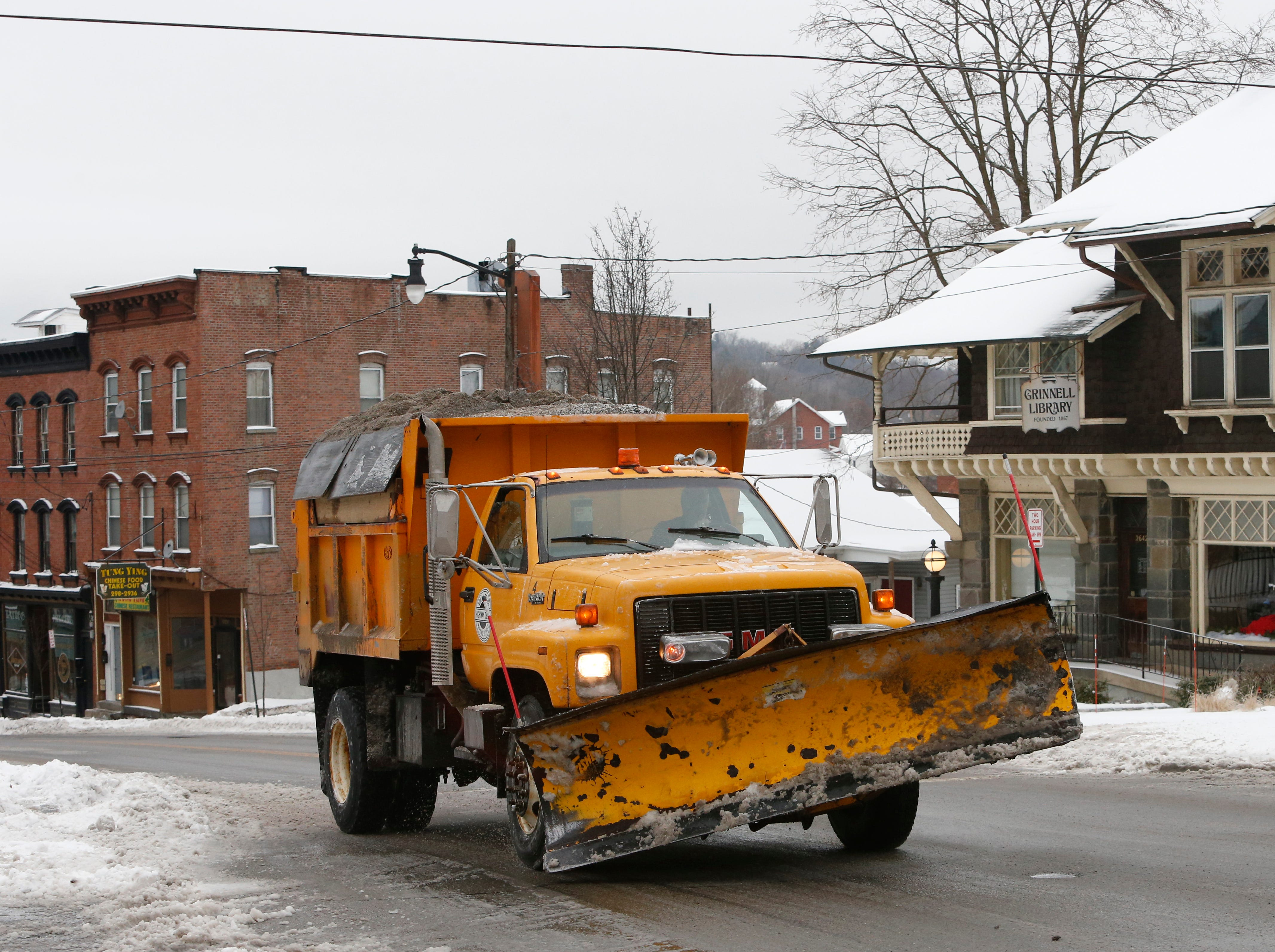 A Village of Wappingers Falls Highway Department plow clears snow along East Main Street on January 20, 2019.