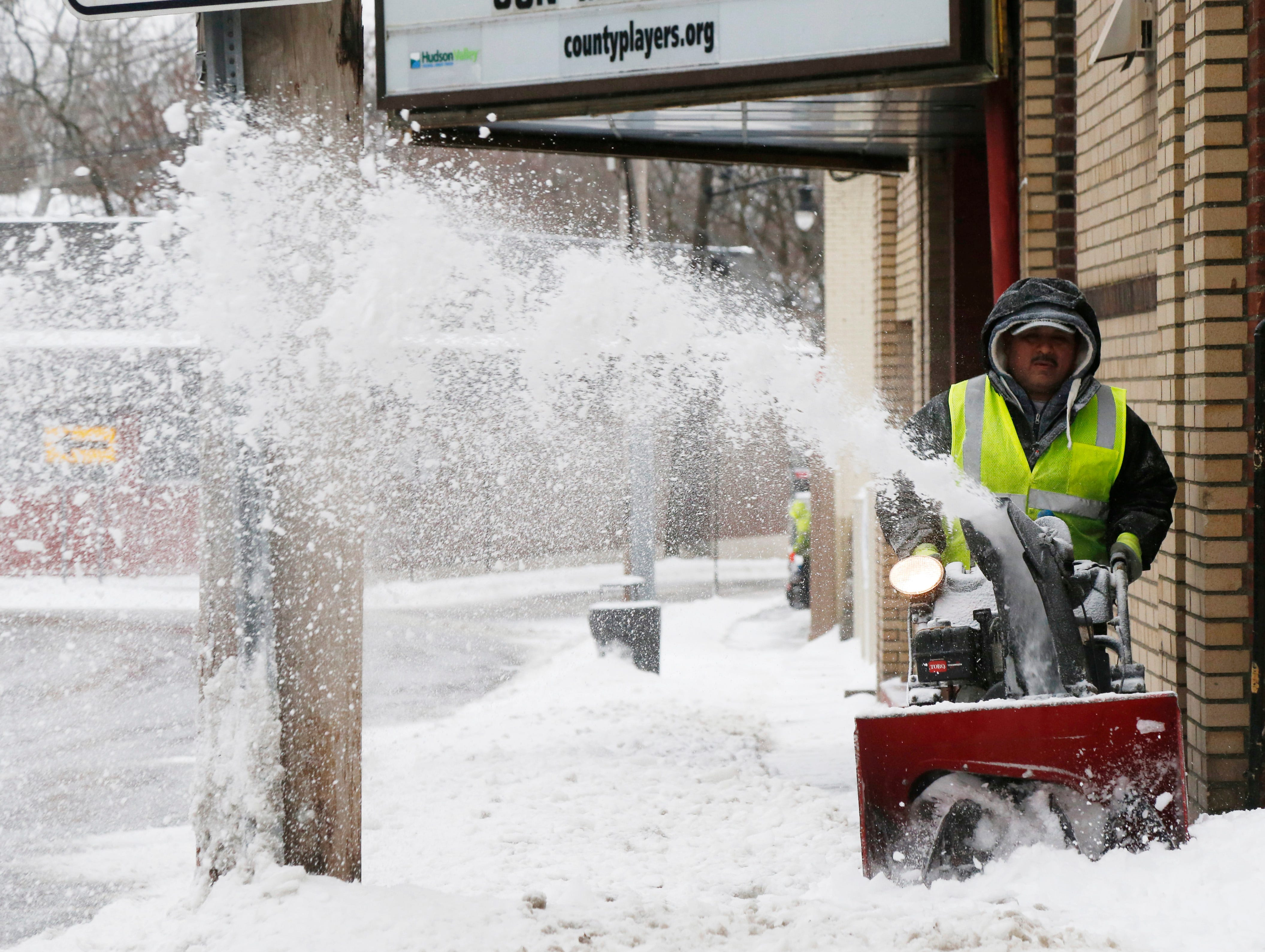 Mauricio Sibada clears the sidewalk along West Main Street in the Village of Wappingers Falls on January 20, 2019.