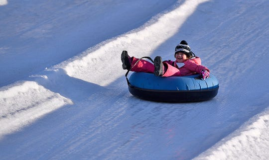 Emily Walsh, 6 of Nottingham, PA, races down the hill while snow tubing at AvalancheXpress, Sunday, January 20, 2019. Conditions are prime on the hill with at least 6 lanes open tomorrow. Hours for Monday are 9a.m.-10p.m. For more information visit www.avalanchexpress.com.