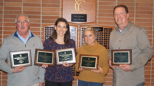 The new members of the York Catholic Athletic Association Hall of Fame are, from left: Dave Strine, Genevieve McGann, Angelina Ortenzio and Tim Marks. Missing from the photo were Lisa Bornt-Davis, Mary McGann and Tom Zielinski.