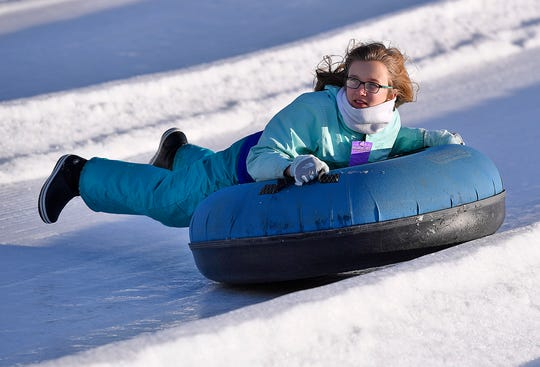 Allie Doutrich, 11, of Gap PA, races down the hill while snow tubing at AvalancheXpress, Sunday, January 20, 2019. Conditions are prime on the hill with at least 6 lanes open tomorrow. Hours for Monday are 9a.m.-10p.m. For more information visit www.avalanchexpress.com.