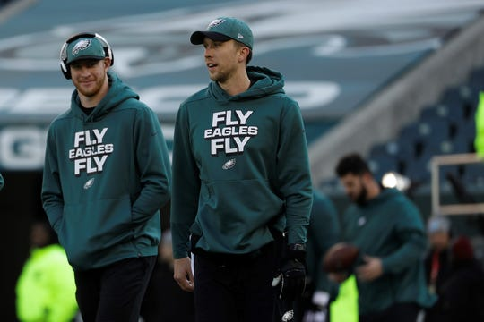 Philadelphia Eagles quarterbacks Nick Foles, right, and Carson Wentz are seen here together before a game in December. In the last two years, the Eagles often enjoyed more success with Foles as the team's starter. Still, Wentz is considered the Eagles' QB of the future.
