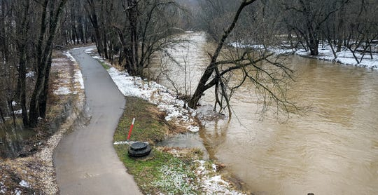 Rain has washed slush from the York County Heritage Rail Trail in SpringettsburyTownship as water rides high in the Codorus Creek at Emig Road on Sunday after a night of heavy rain.