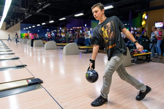 Cayden Scogin bowls in the Relay for Life kickoff event.