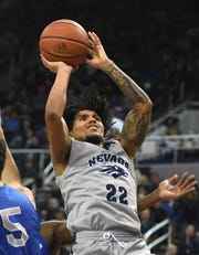 Nevada's Jazz Johnson shoots against Air Force during Saturday's Mountain West game in Reno.