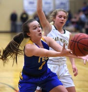 Reed junior Emma Johnson battles against Bishop Manogue in a girls basketball game earlier this month.