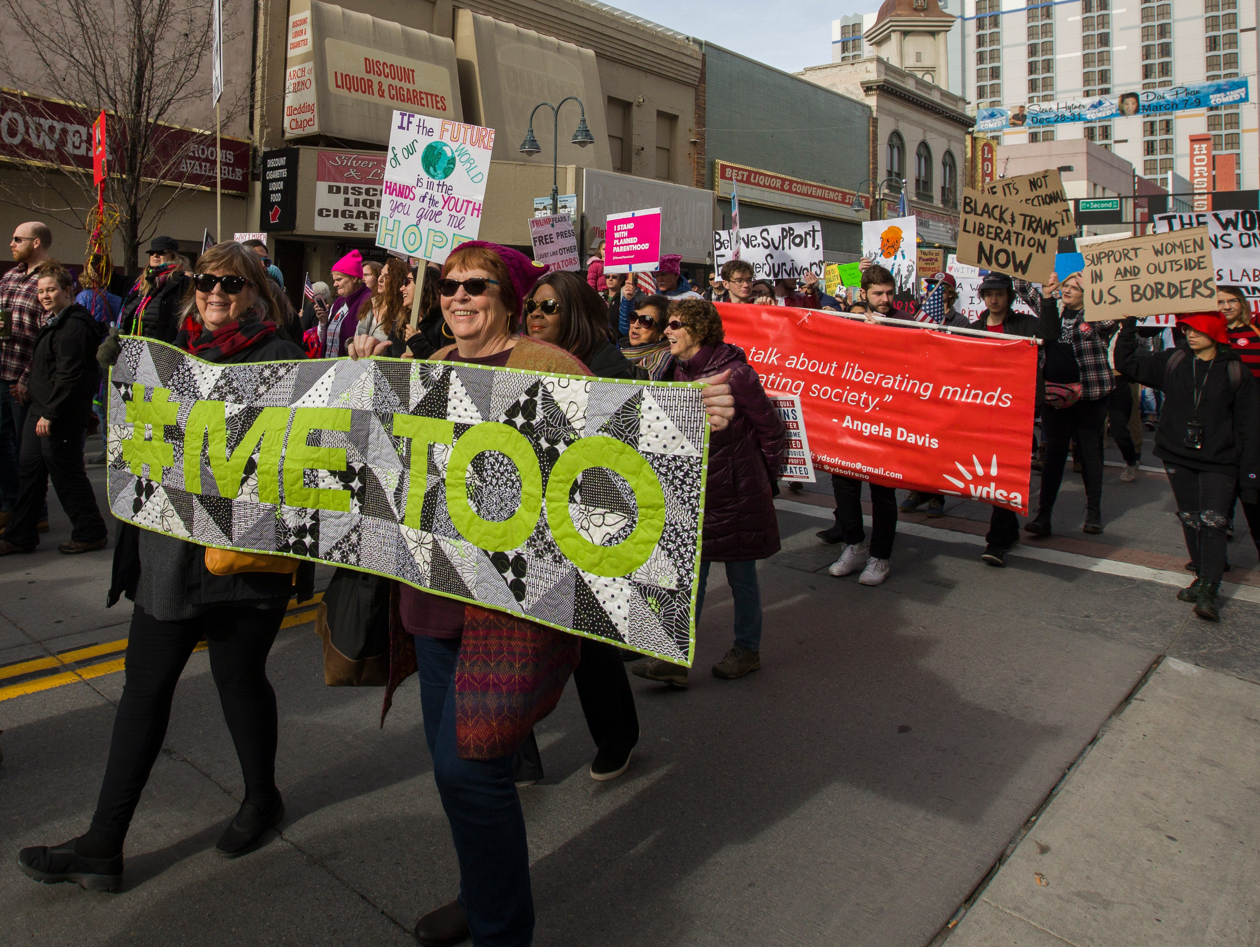 "Giga Hickey and Pat Macdonell hold a ""#Me Too"" quilt during the 3rd Annual Reno Women's March in downtown Reno on Saturday, January 19, 2019.."