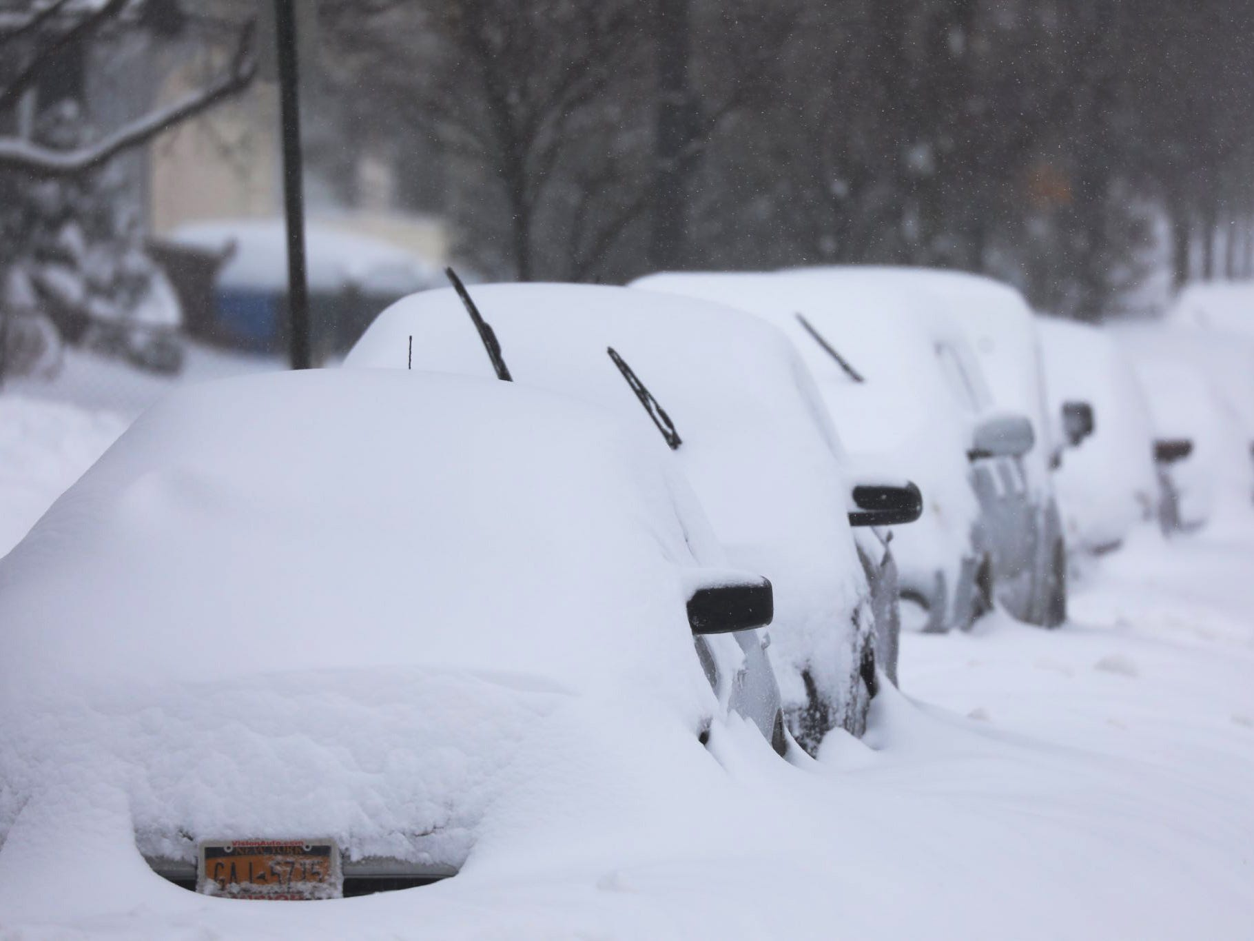 A familiar sight in Rochester today: Cars buried in snow.