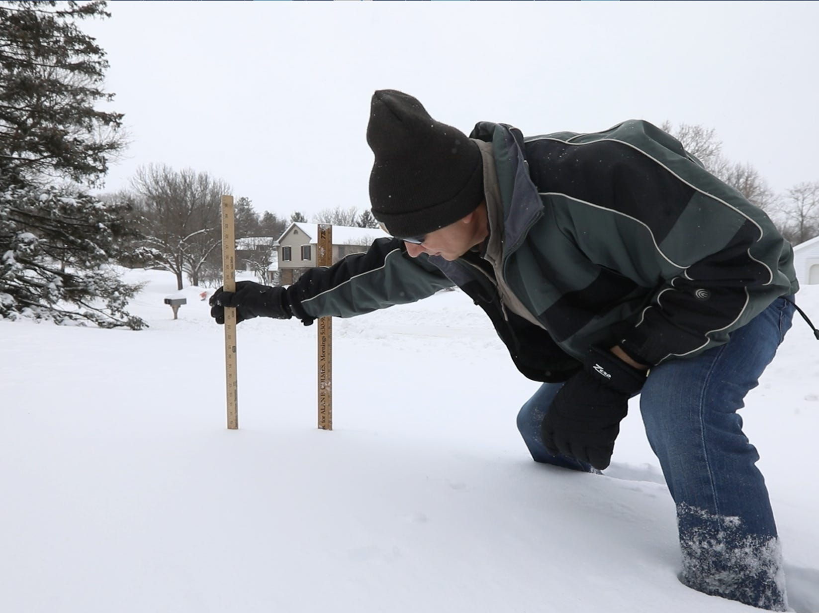 Keith Eichner of Pittsford measures the snowfall in his front yard around 1 p.m, Jan. 20, 2019.  He was taking the measurement as a volunteer weather spotter for both the National Weather Service and the Community Collaborative Rain, Hail & Snow Network.  Because this was a significant snow event, he was taking the measurement every six hours for the National Weather Service.