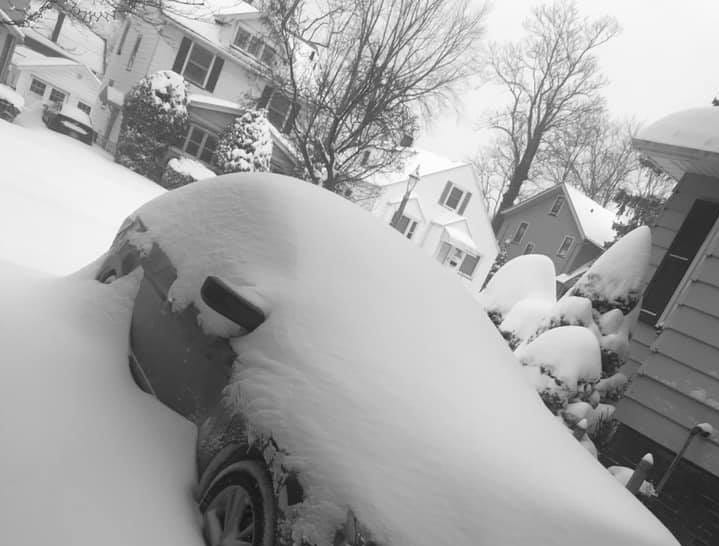 Car buried in snow on Laurelton Road in Irondequoit. Photo by Kelly Suzanne.