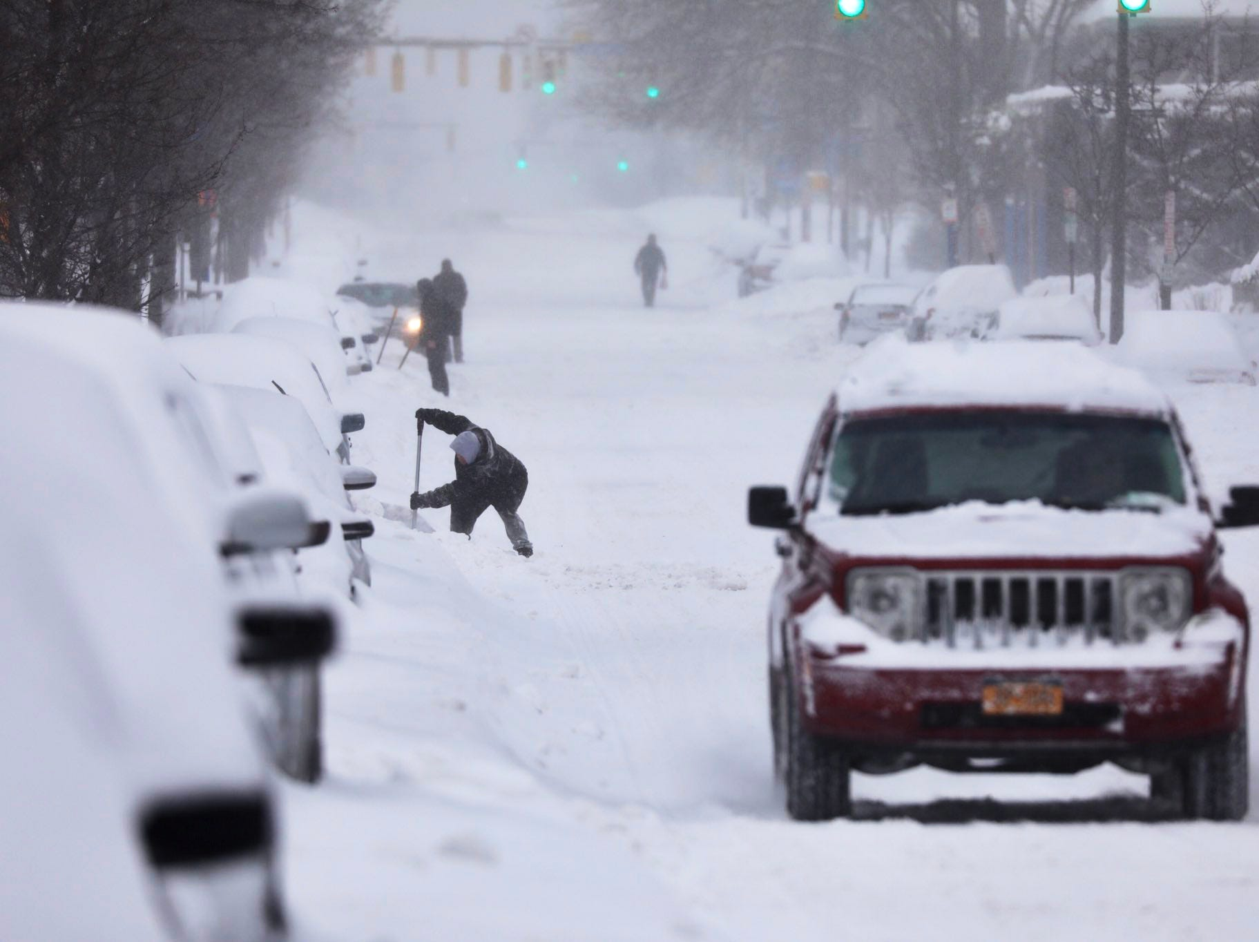 Residents try to dig out on Monroe Avenue Sunday morning.