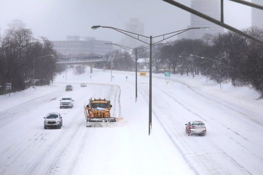 A plow clears Interstate 490 in this photo taken from Alexander Street.