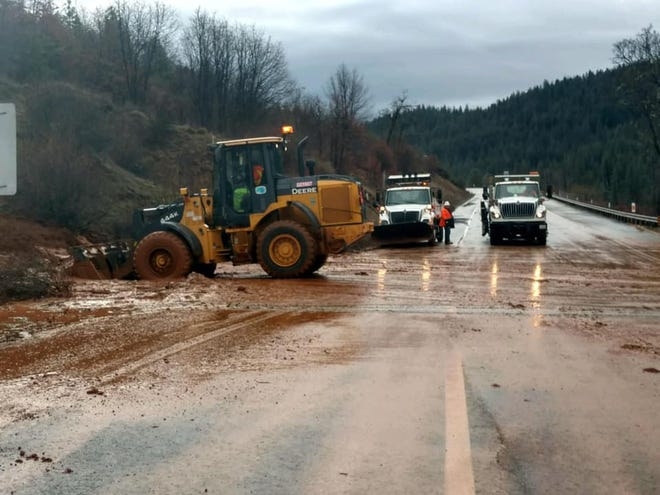 Caltrans crew clears mud and debris from Highway 299 west of Weaverville on Sunday.