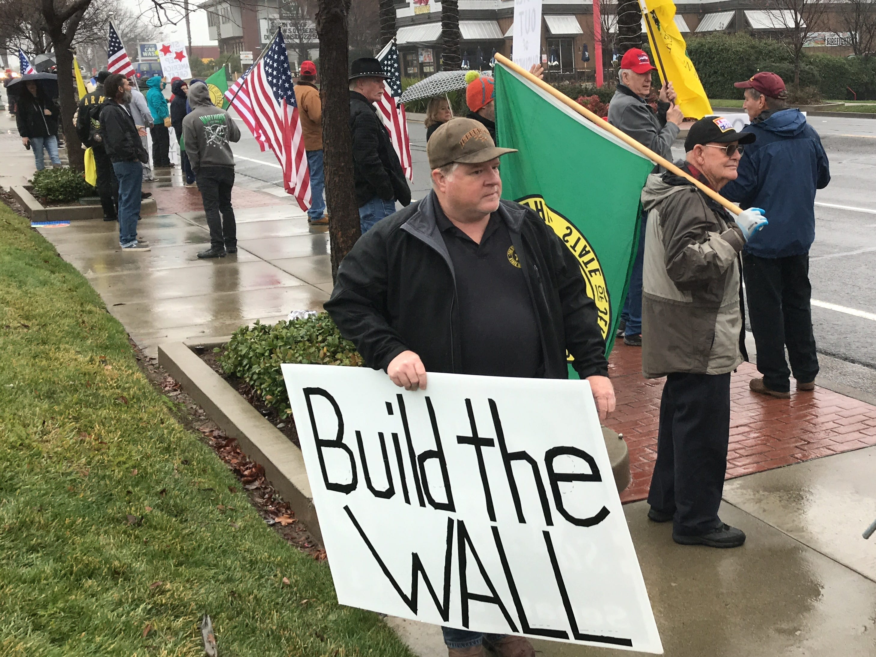 A Build That Wall! rally brought demonstrators to Hilltop Drive in Redding.