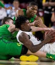 Arizona State's Romello White (23) controls the ball as he battles against Oregon's Payton Pritchard (3) and Francis Okoro (33) during the first half of an NCAA college basketball game Saturday, Jan. 19, 2019, in Tempe, Ariz. (AP Photo/Darryl Webb)