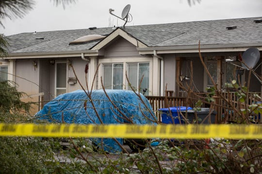 Crime scene tape surrounds a property as they investigate a quadruple murder where the suspect was shot and killed by deputies on Saturday night. Photographed on the 32000 block of Barlow Rd. S near Canby on Sunday, Jan. 20, 2019.
