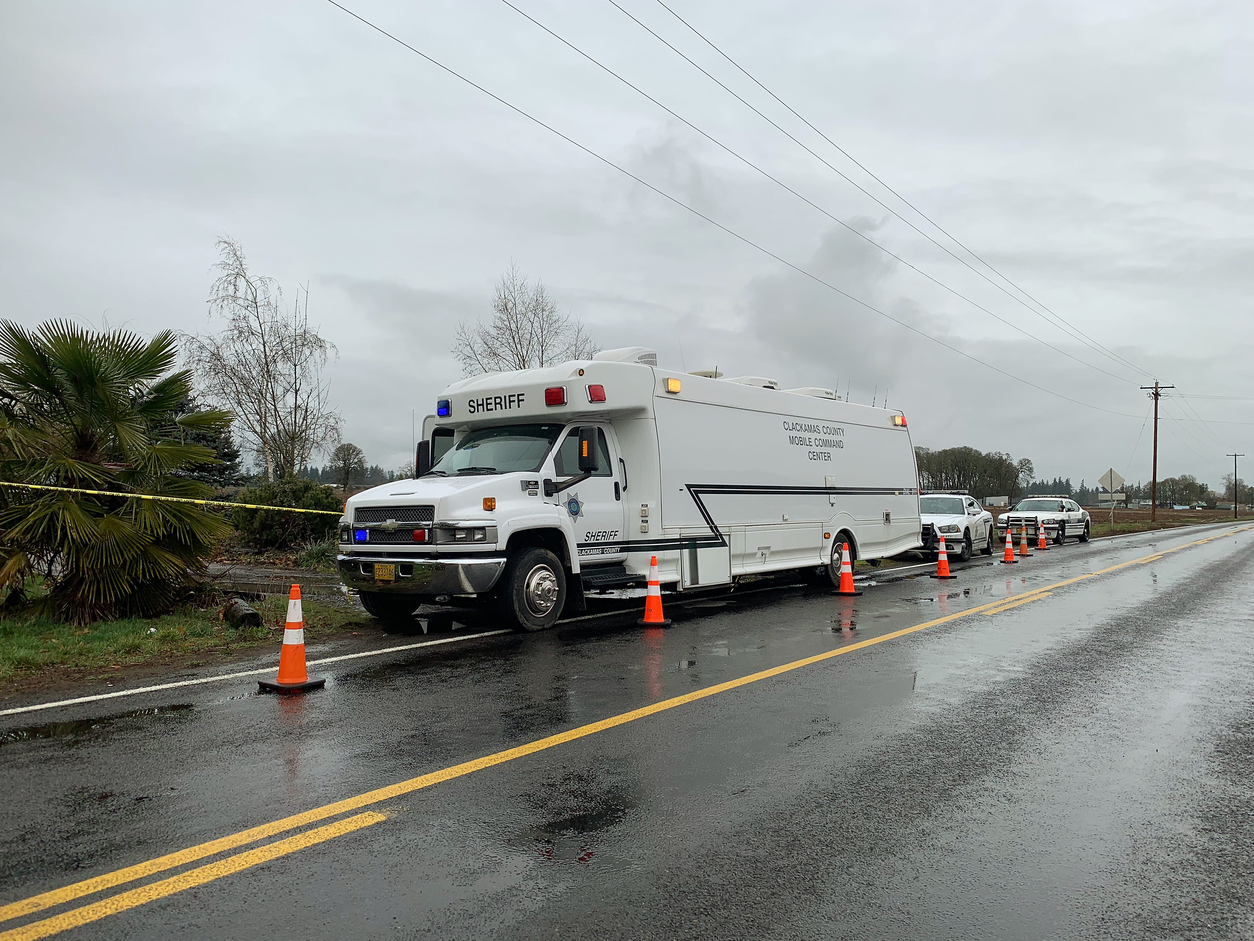 The Clackamas County Sheriff mobile command unit sits outside of a property as they investigate a quadruple murder where the suspect was shot and killed by deputies on Saturday night. Photographed on the 32000 block of Barlow Rd. S near Canby on Sunday, Jan. 20, 2019.