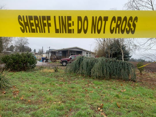 "Clackamas County Sheriff's Office Sgt. Brian Jensen said the scene of the Jan. 19 quadruple homicide on the 32000 block of Barlow Rd. S. near Canby was ""one of the most gruesome scenes"" officers had seen in their careers. Crime scene tape outlines the property on Jan. 20, 2019."