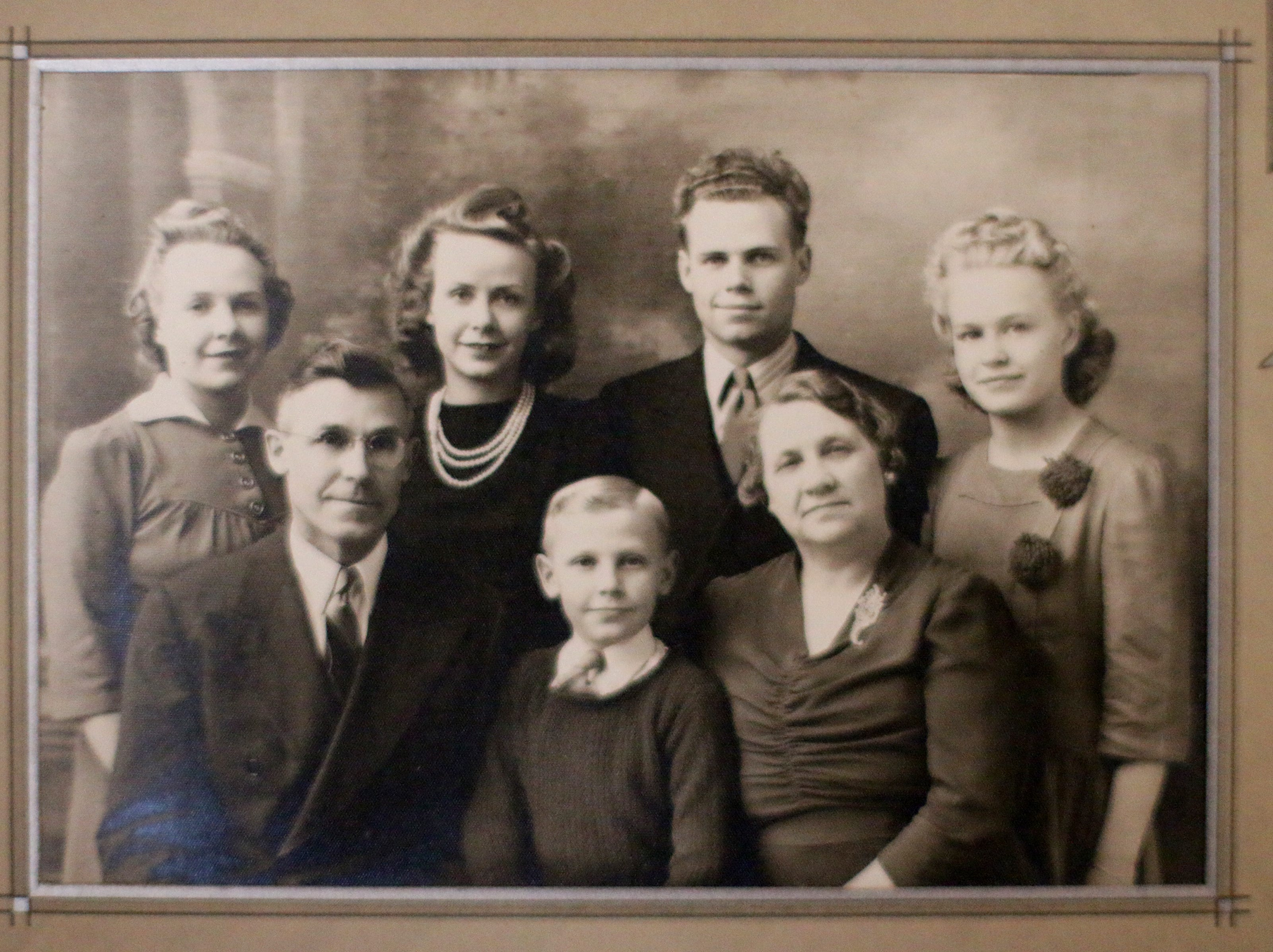 World War II veteran Don Harder, back row third from left, appears in pre-war family photo on display,  Friday January 18, 2019, 2019, at Pine Haven Christian Communities in Oostburg, Wis.