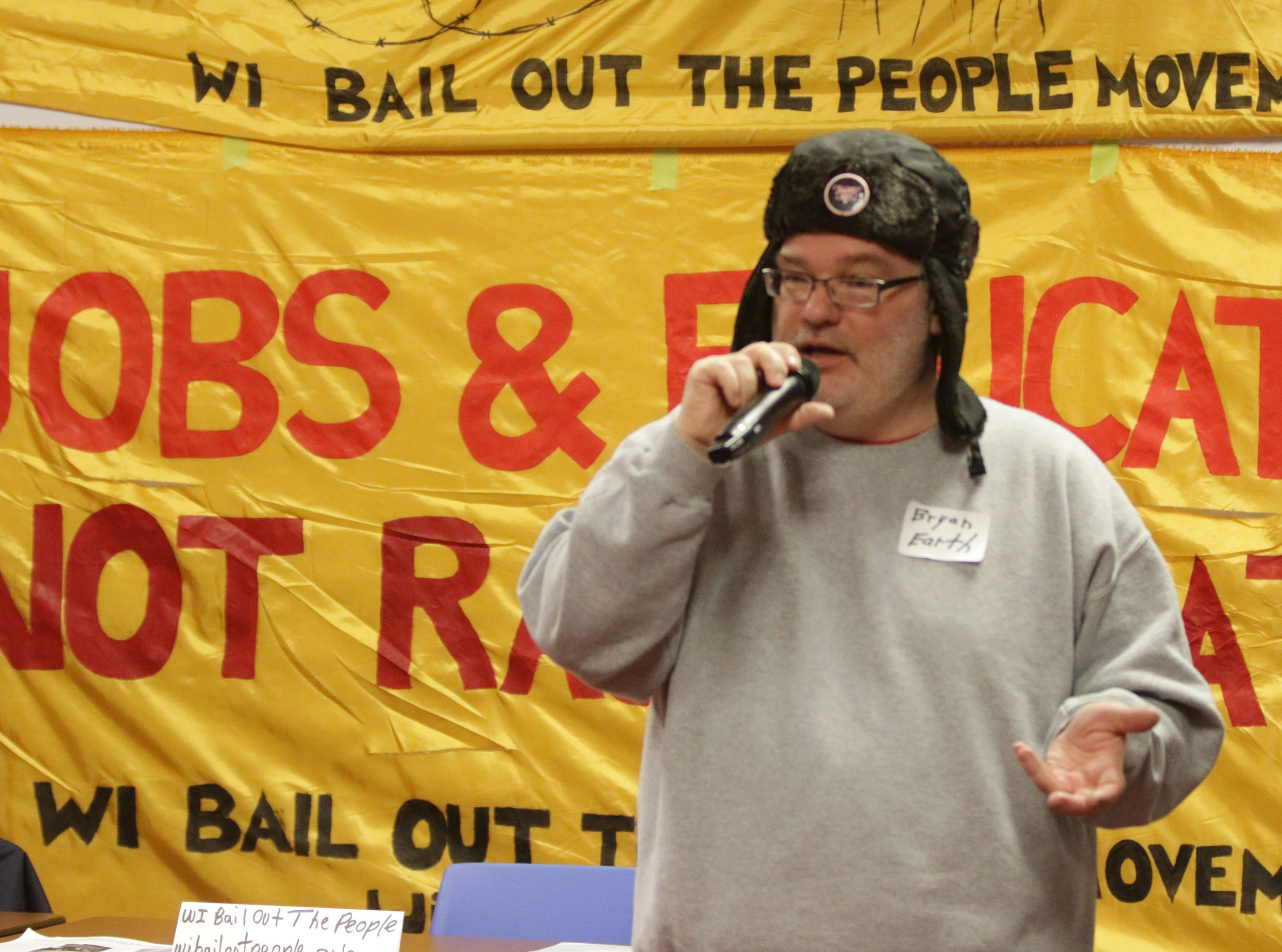 Bryan Pfeiffer of Wisconsin Bail Out the People, speaks, Saturday, January 19, 2019, in Sheboygan, Wis. The event focused on human rights, immigration, economic justice and drug abuse issues.