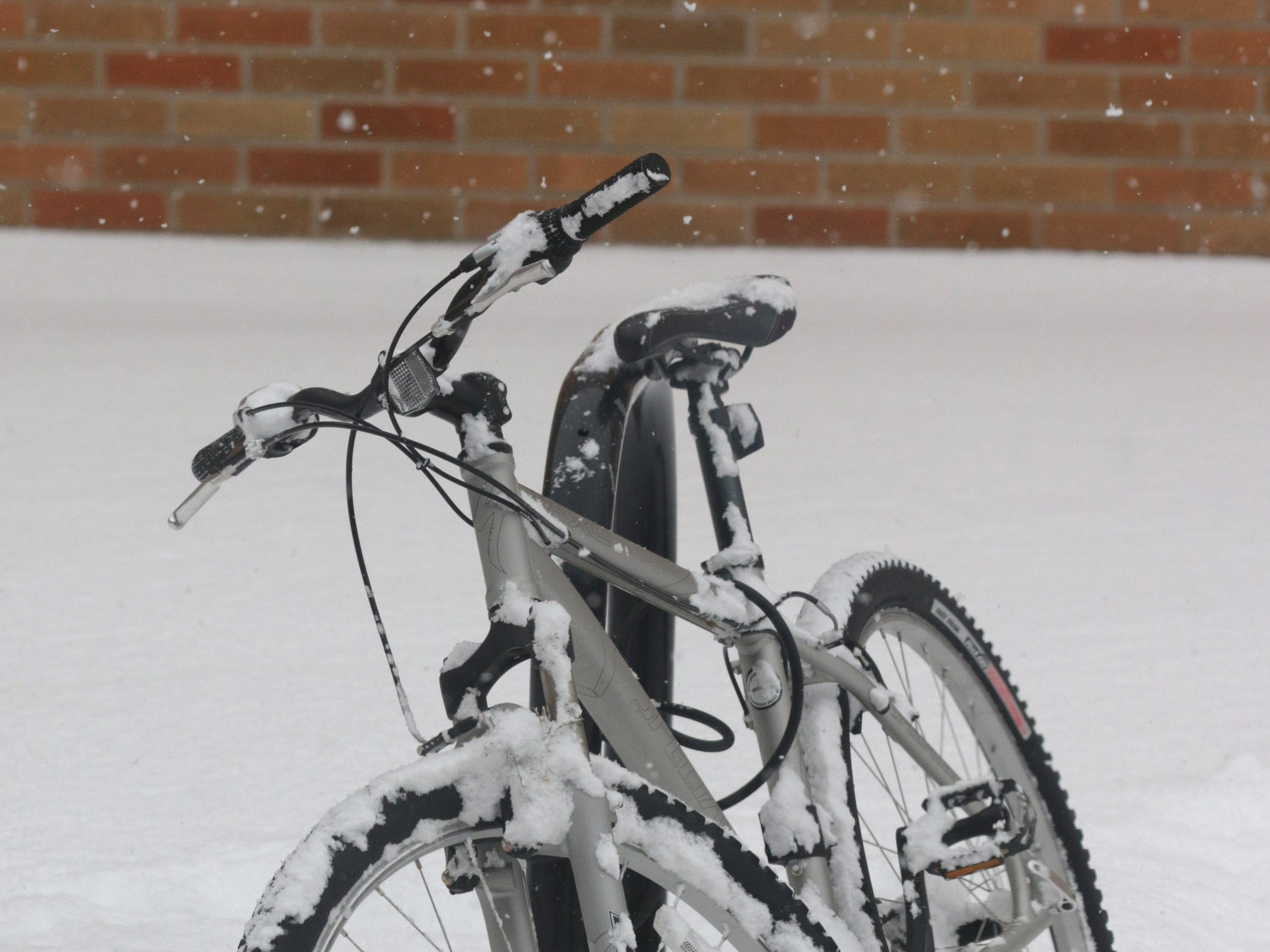 A bicycle, covered in snow near Mead Library, Saturday, January 19, 2019, in Sheboygan, Wis.