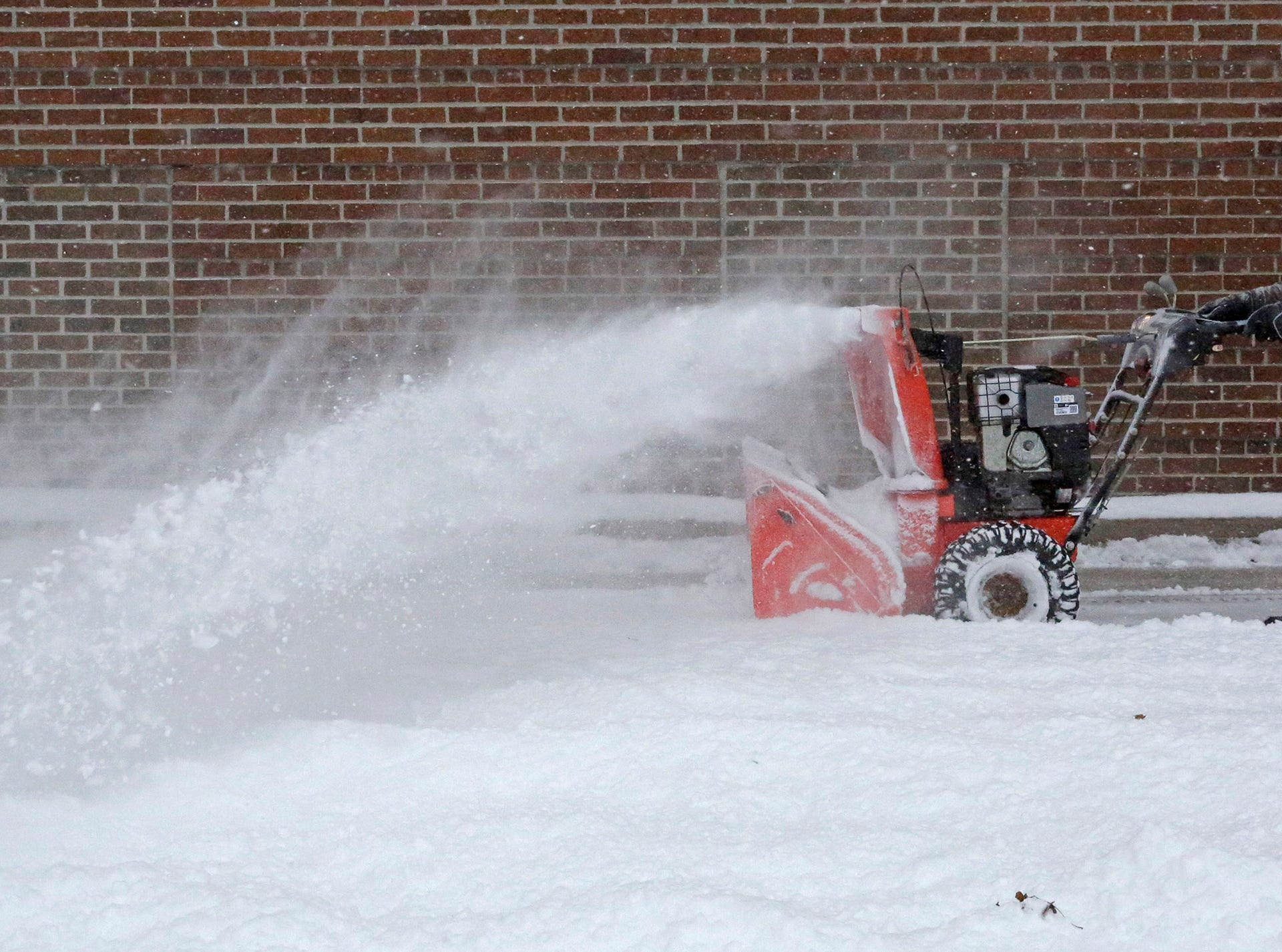 Sheboygan County's Mark Larson removes snow at the Human Services building, Saturday, January 19, 2019, in Sheboygan, Wis.