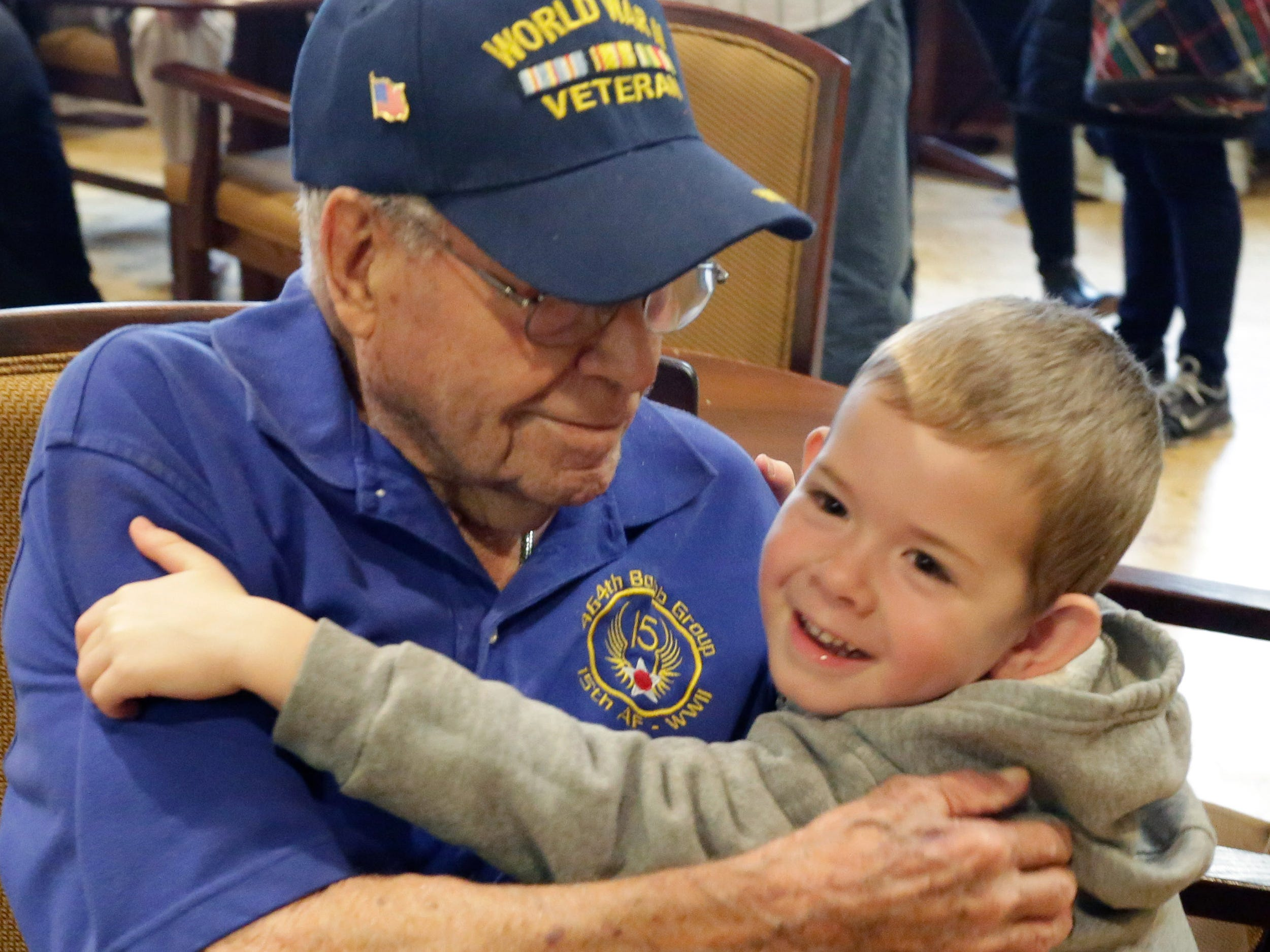 100-year-old World War II veteran Don Harder of Oostburg, left, hugs Malachi Rauwerdink, 4, of Oostburg, Friday January 18, 2019, 2019, at Pine Haven Christian Communities in Oostburg, Wis. Harder's birthday was celebrated at Pine Haven.