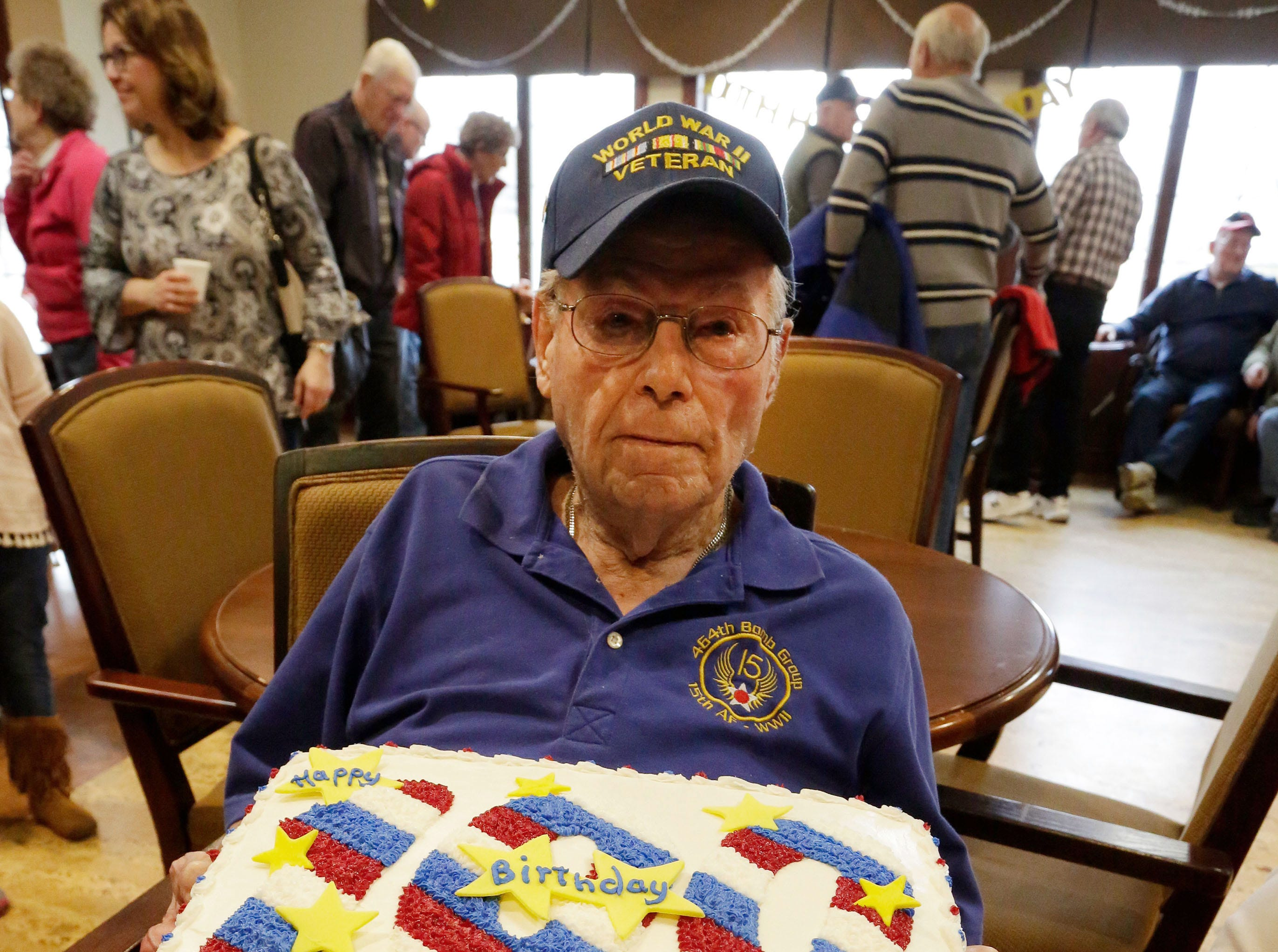 100-year-old veteran Don Harder poses with his birthday cake, Friday January 18, 2019, 2019, at Pine Haven Christian Communities in Oostburg, Wis.