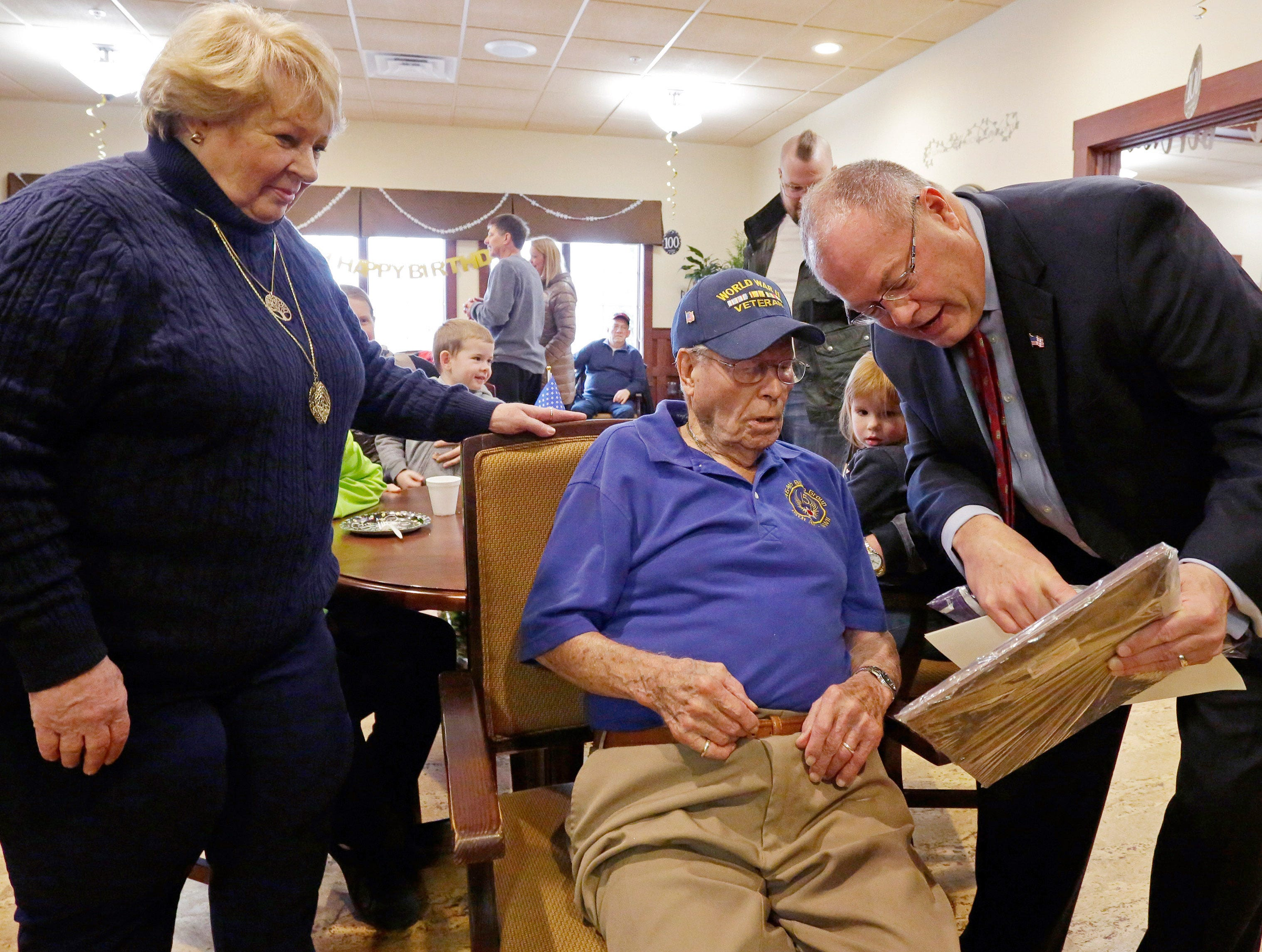 State Representative Terry Katsma, right, reads a proclamation honoring Don Harder for his years of service Friday January 18, 2019, 2019, at Pine Haven Christian Communities in Oostburg, Wis. At left is Harder's daughter Janee McCallum of Seattle, Washington.