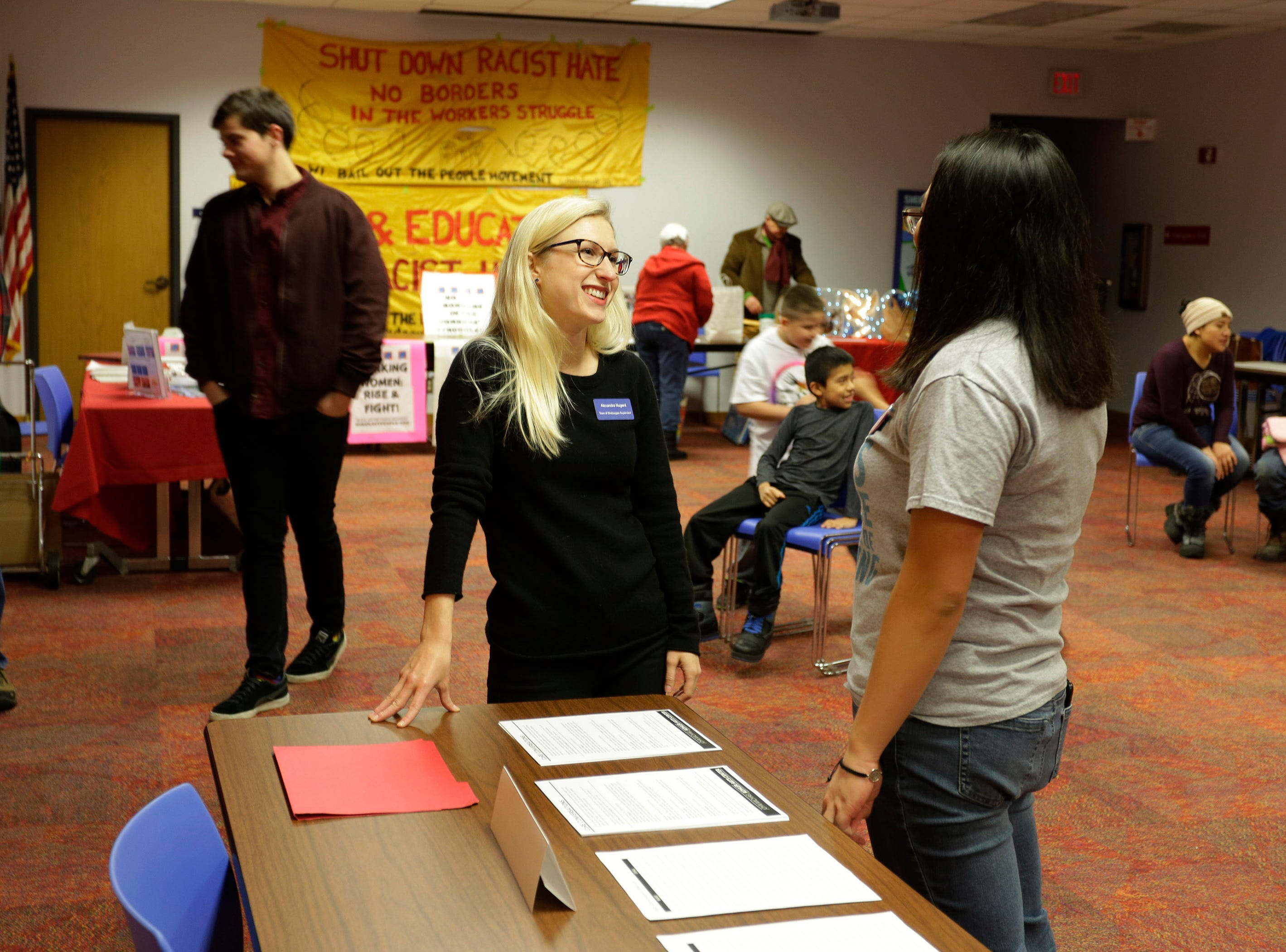 Alexandra Nugent, left, talks to Domini Que Lee at the Sheboygan Community meeting at Mead Public Library, Saturday, January 19, 2019, in Sheboygan, Wis.