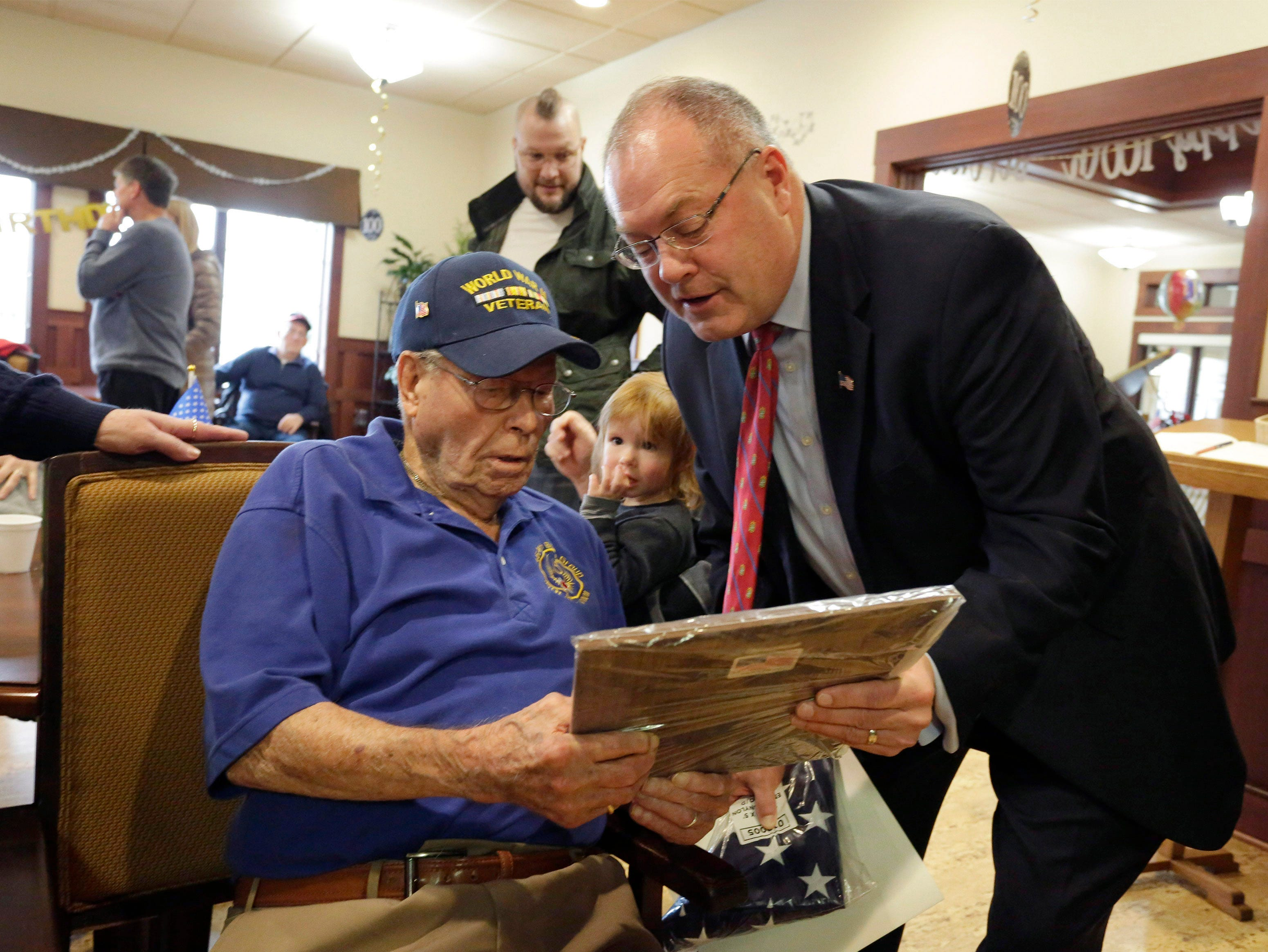 State Representative Terry Katsma, right, reads a proclamation honoring Don Harder for his years of service, Friday, January 18, 2019, at Pine Haven Christian Communities in Oostburg, Wis.  Harder, a World War II veteran, turned 100-years-old.