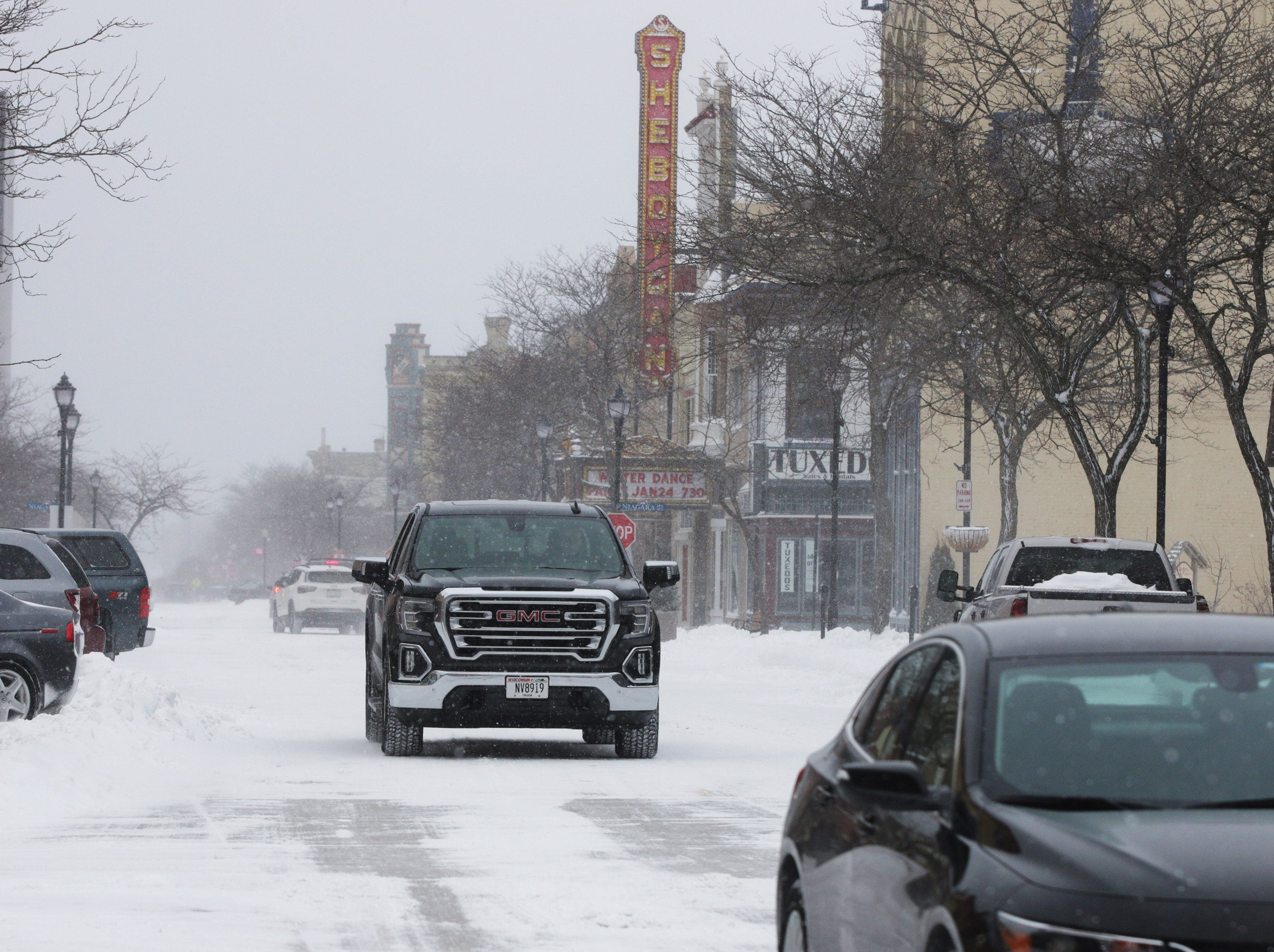 A truck drives along North 8th Street, Saturday, January 19, 2019, in Sheboygan, Wis. Several inches of snow fell, slowing traffic and making snow removal a big activity.