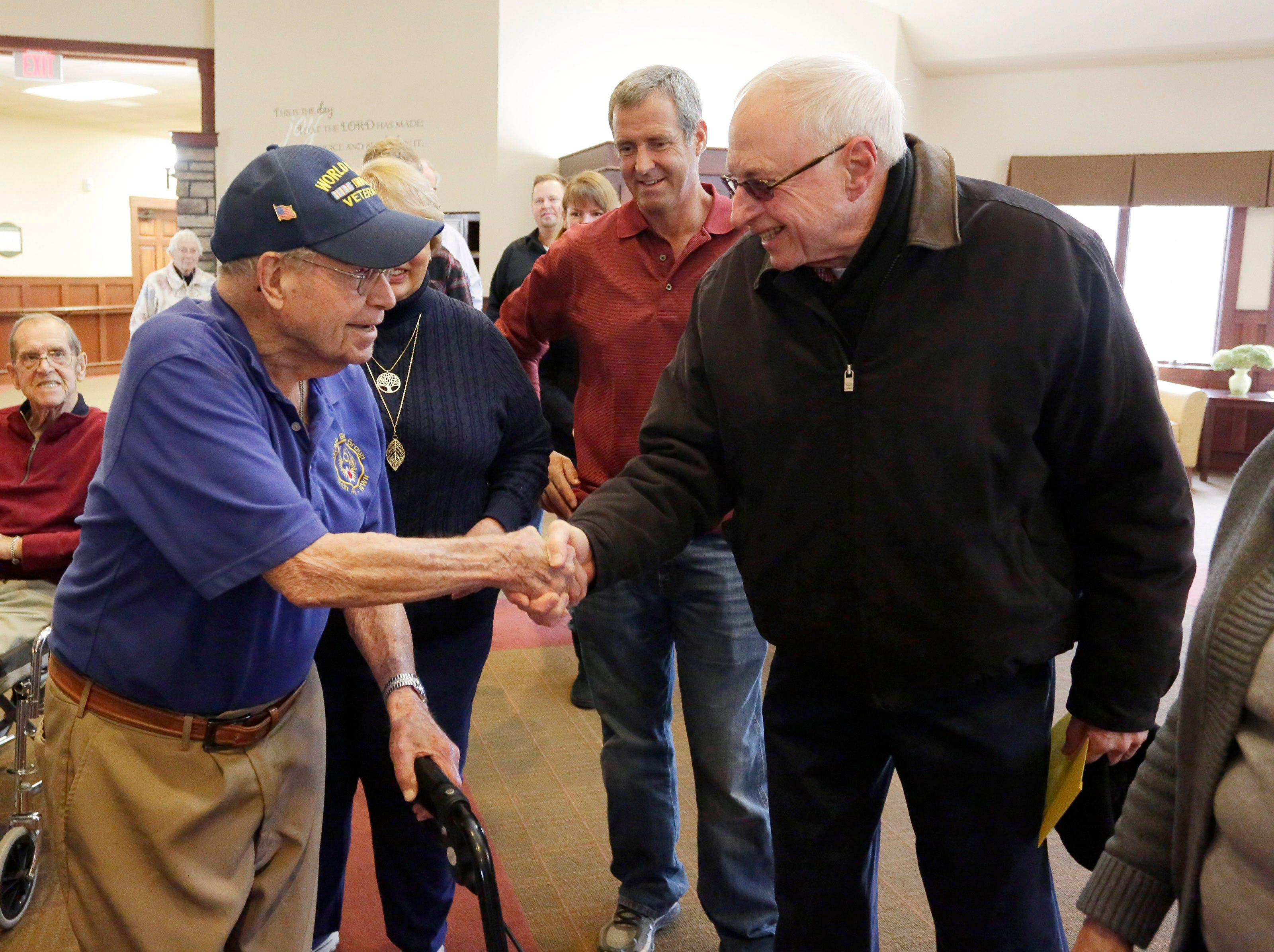 Oostburg resident Don Harder, left, greets Jim Eckwielen of Oostburg during a celebration of Harder's 100th birthday, Friday January 18, 2019, 2019, at Pine Haven Christian Communities in Oostburg, Wis.